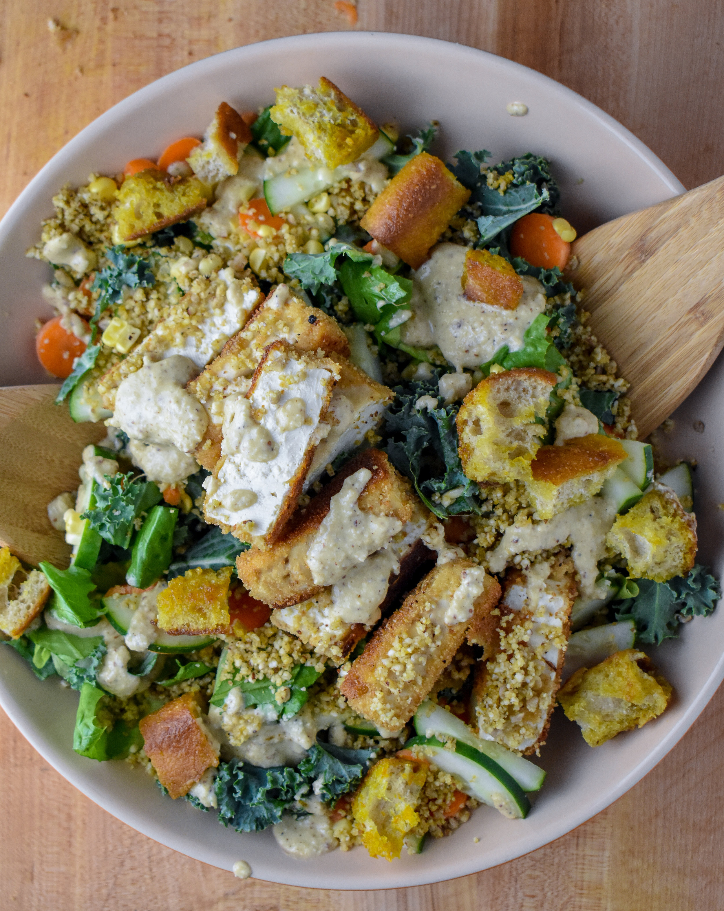9. It's time to put together the salad. Divide the lettuce into four small bowls or serve in one large bowl. Add kale + romaine, chopped veggies, parm, croutons, and cutlets (chopped into smaller pieces). Drizzle on dressing, mix + serve. Eat! Enjoy!