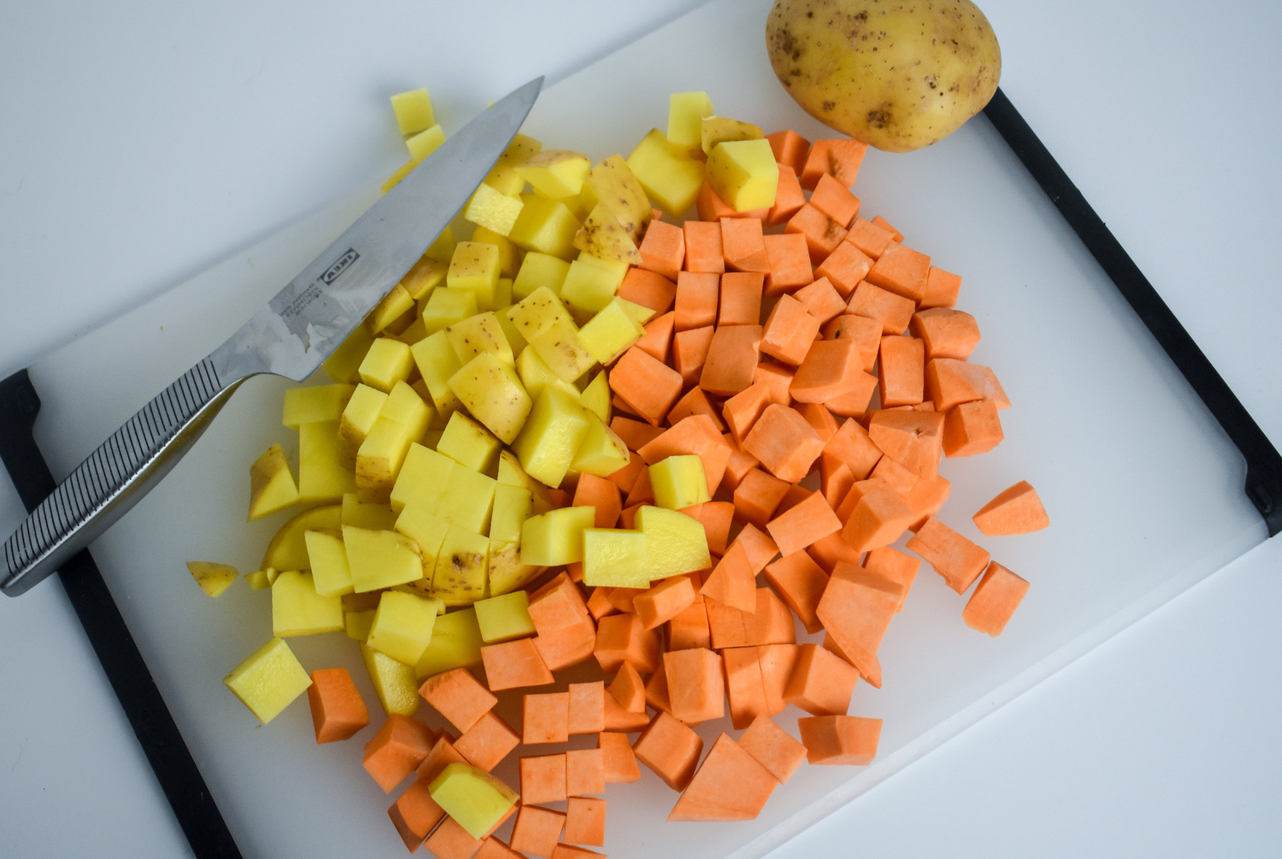 1. Start by cubing your potatoes into small bit size chunks. Add the cubes to a bowl with water and put in microwave for 5 minutes.