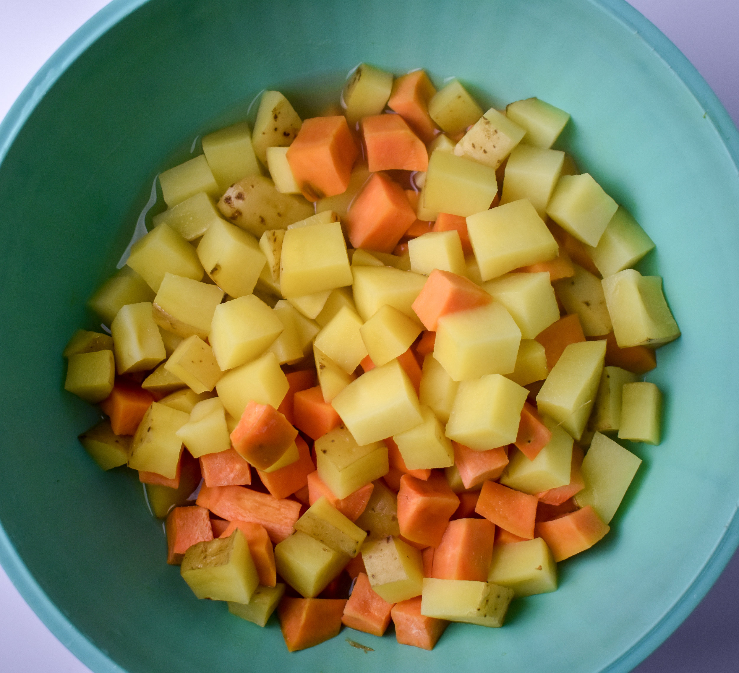 3. Once the potatoes are done in the microwave, carefully remove + stir. Place back into the microwave and cook for another 5 minutes. Once done, set aside until castiron pan is done on the veggies.