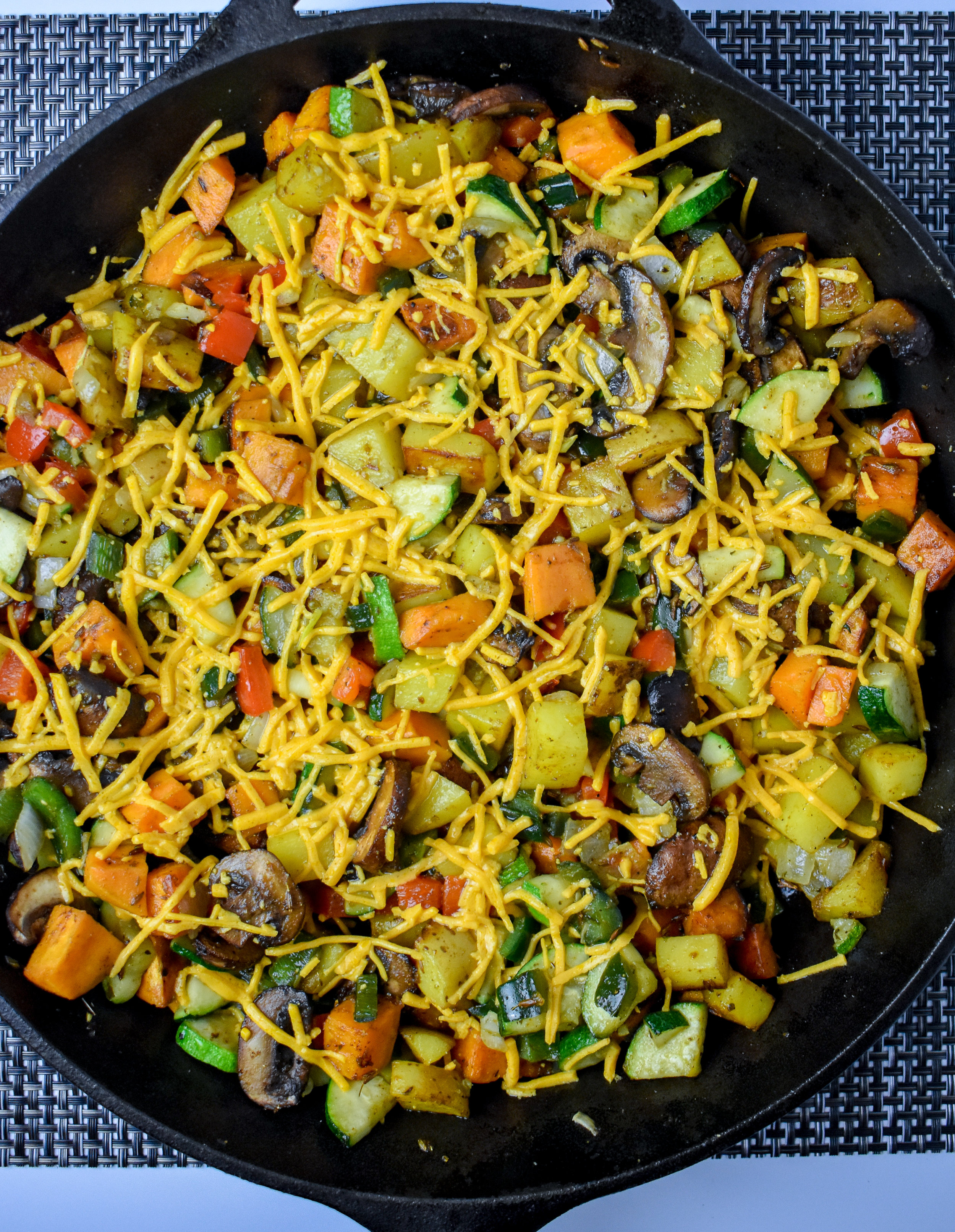 7. Next, once the potatoes are done. Turn off the heat. Add in the veggies +mushrooms. Mix well. Sprinkle on cheese + green onions. Let sit.