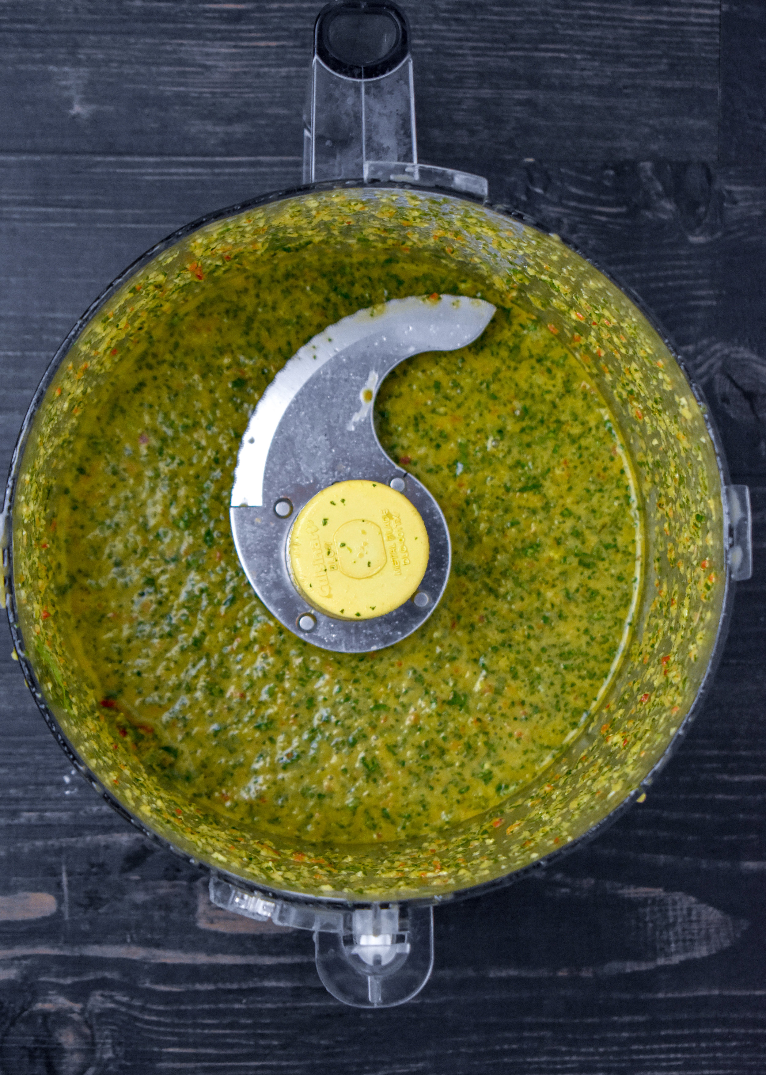 2. While the corn cooks, add all your chimichurri ingredients to a food processor or high-speed blender and mix for 15-20 seconds. Scrape down the sides and repeat.