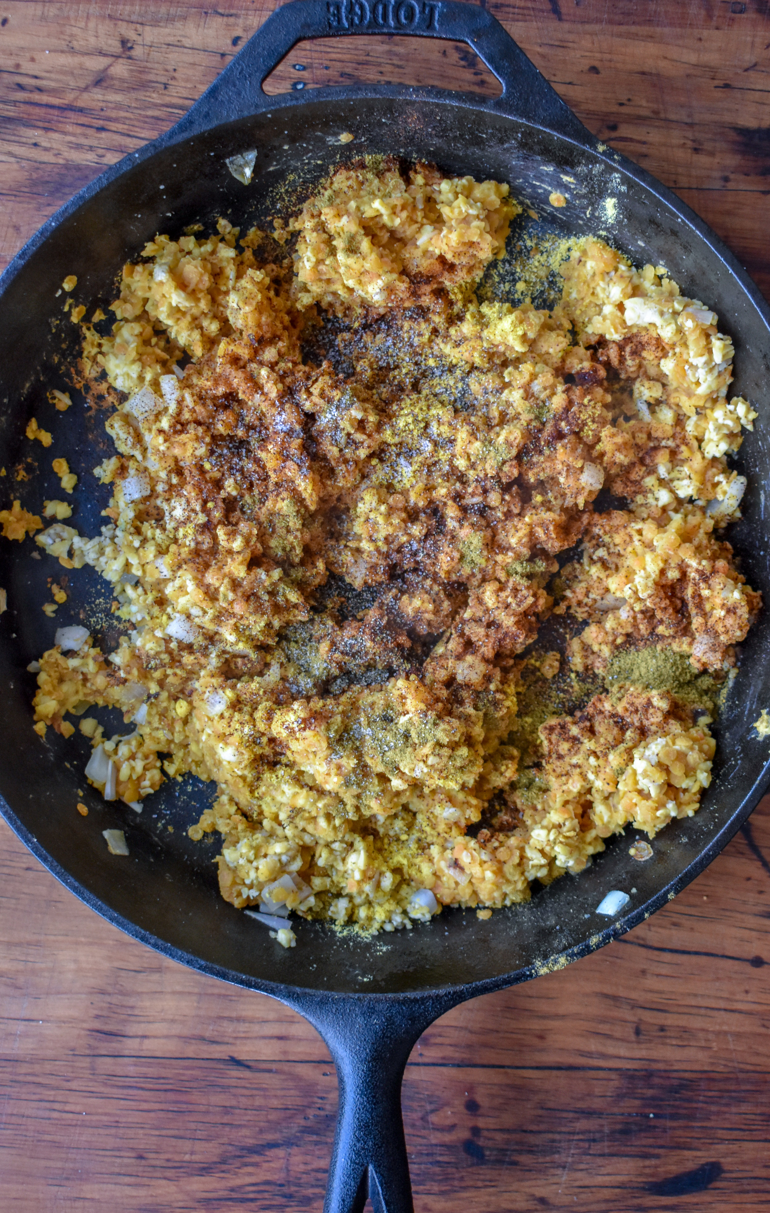 3. If onions + garlic finish before lentils, take them off heat. Once lentils are done, add lentils, blended tempeh and all the spices for sloppy joes to the pan. Mix well and cook for 2-3 minutes over medium heat, stirring frequently.