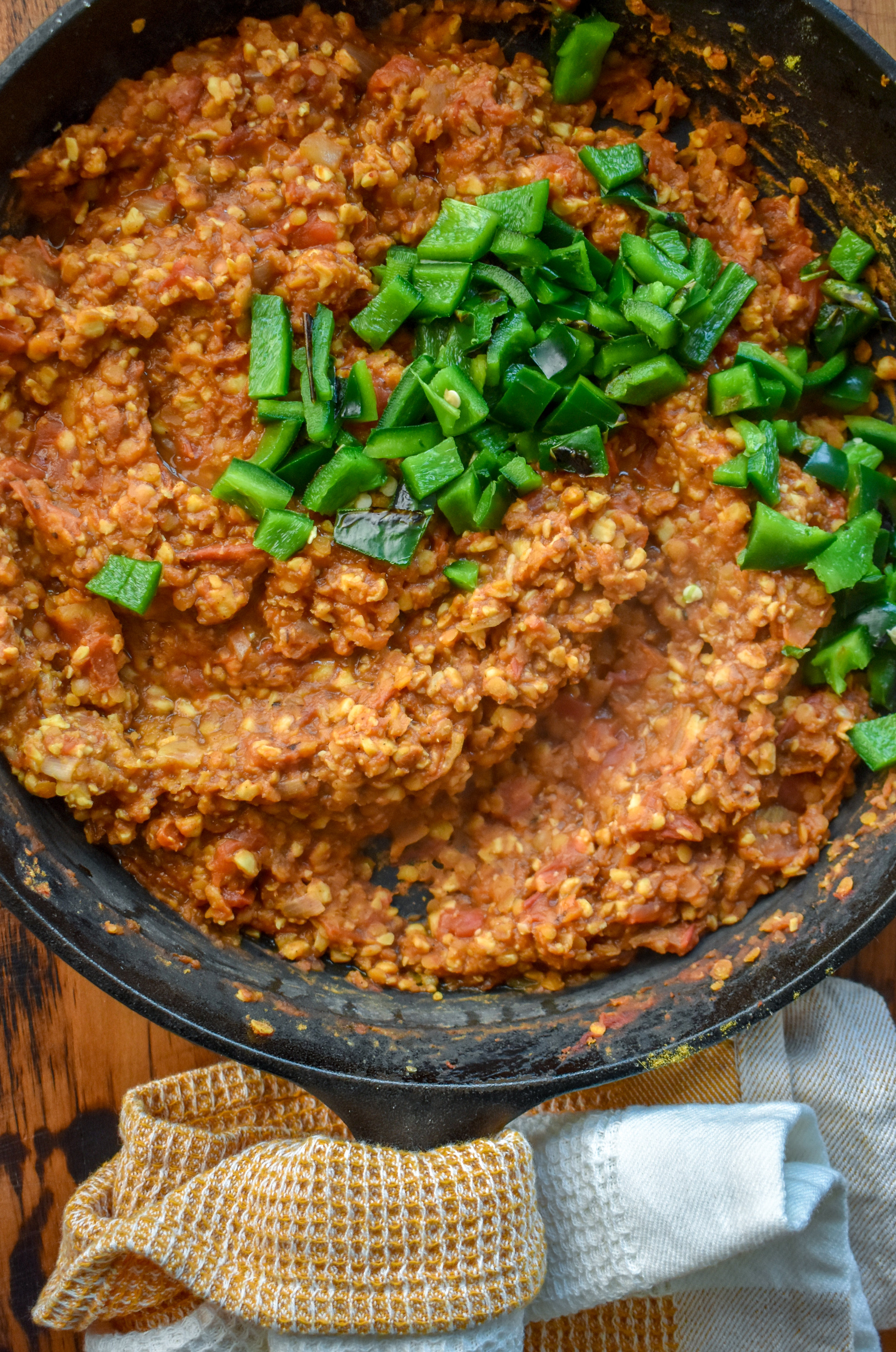 5. Add the rest of the sloppy joe ingredients to the pan and turn the heat to medium low. Once the poblano is charred, pull off the stove and dice carefully (its hot!). Mix that into the mixture. Turn the heat to low and let it simmer while we finish the recipe.