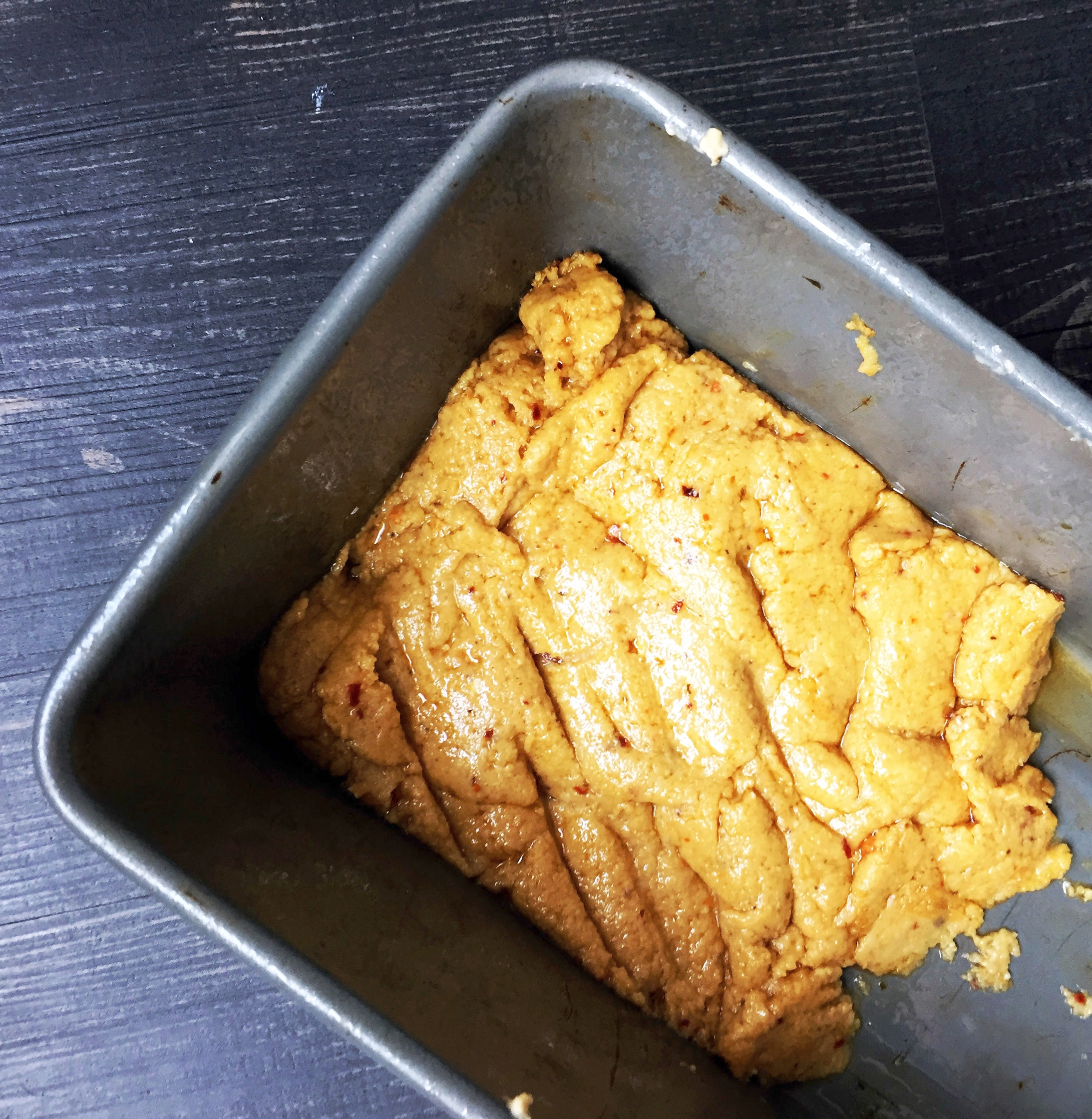 4. Place sauce into a loaf pan that is fairly small. It won't fill the whole pan. You want it to be roughly 1/2 inch thick height. Set in fridge for one hour.