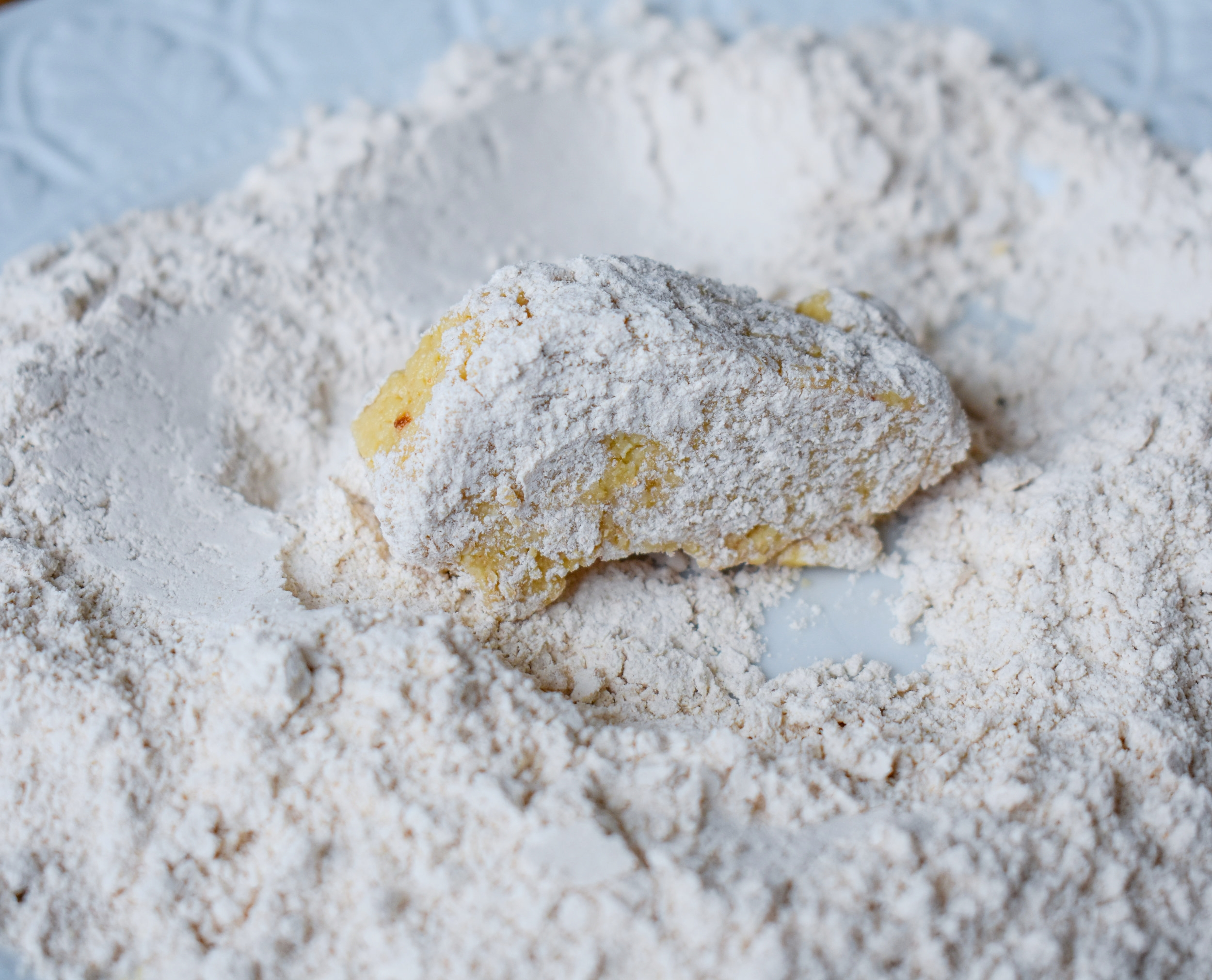 7. To bread, first place sticks into flour quickly to coat.
