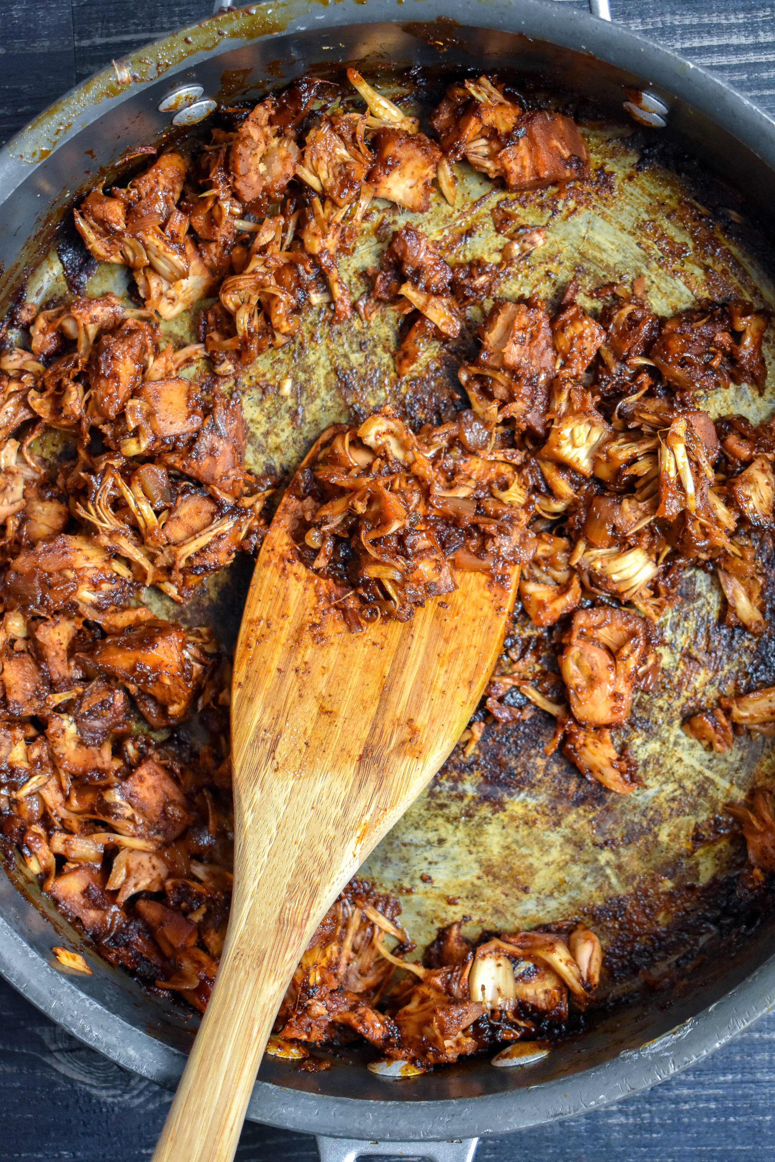 2. Next, add in the BBQ sauce + broth and cook over medium-low heat for 10-15 minutes until the jackfruit starts to get stringy.