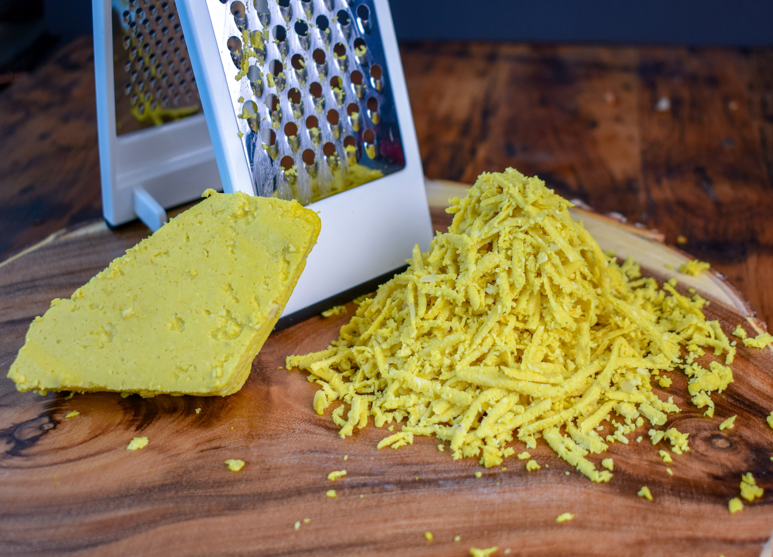 6. Use a cheese grater to great your cheese block. To not crumble it, grate down, pull the bloc off, grate down again.