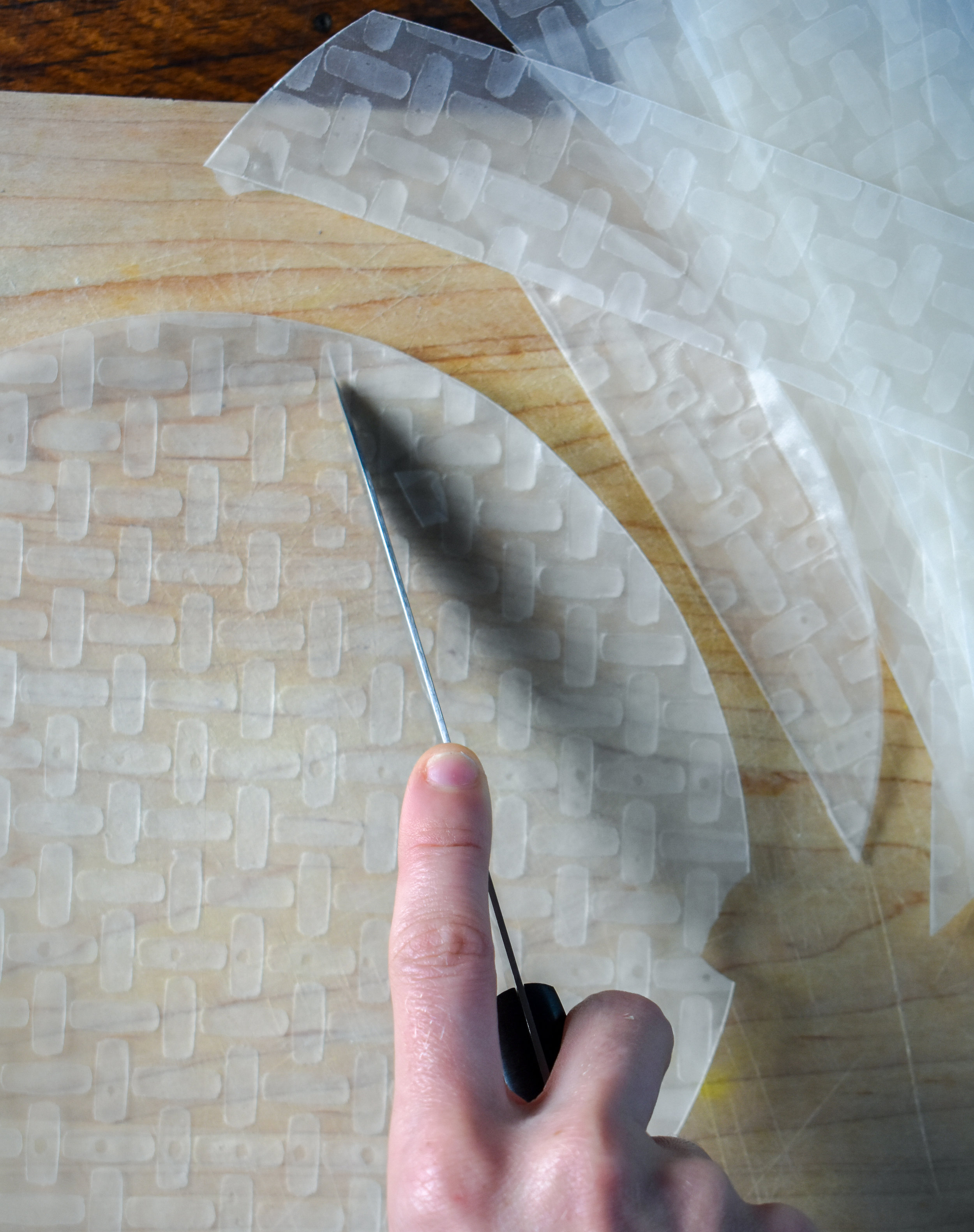1. To start, using a sharp knife, cut 4-5 strips about 1.5-2 inches out of each piece of rice paper. You need to have roughly 35- 40 strips for 4 sandwiches.