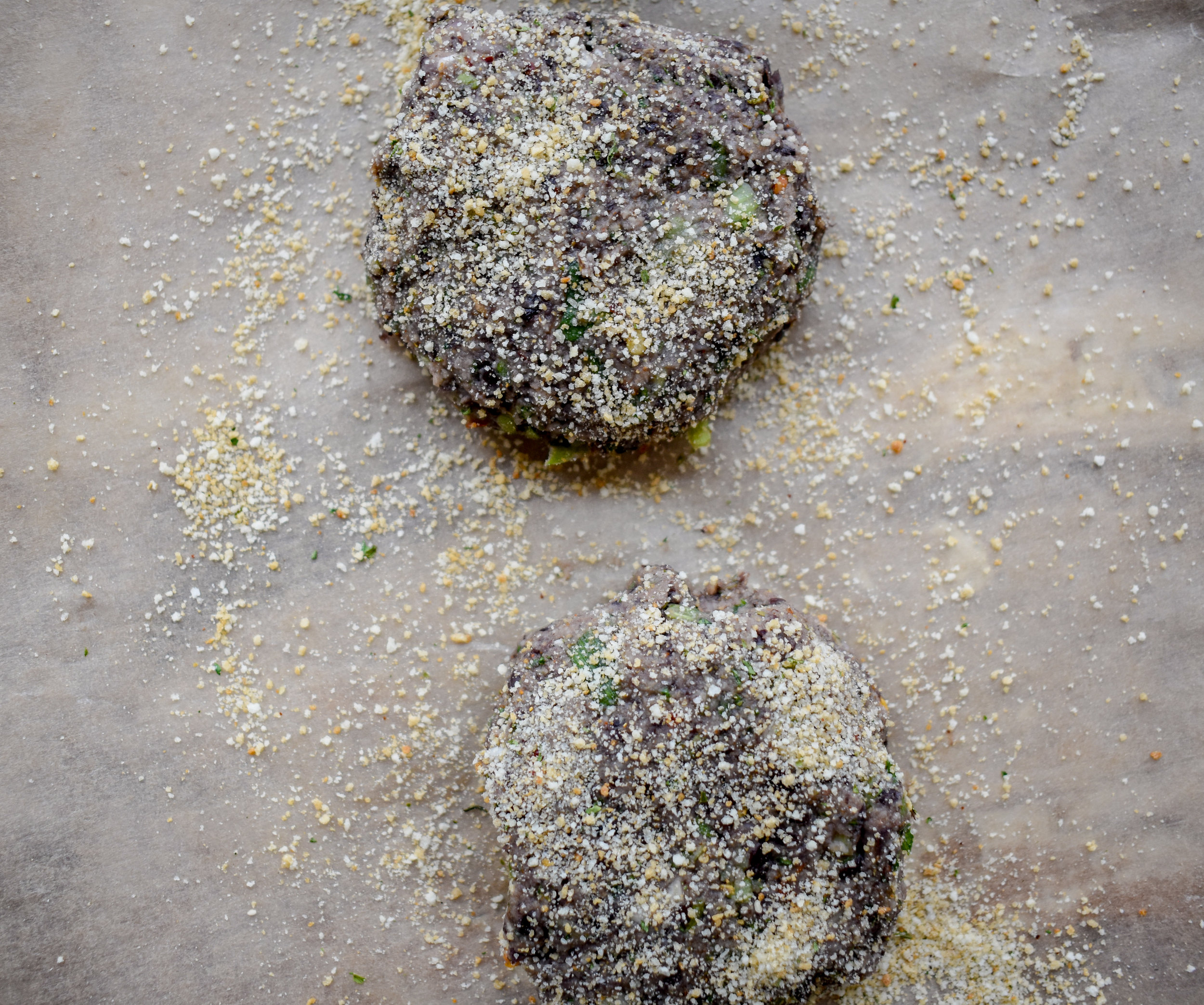5. Form the black bean mixture into 8 patties of equal size. Mine were similar to the size of a sausage patty. Sprinkle the top with breadcrumbs, flip, repeat. Set aside.