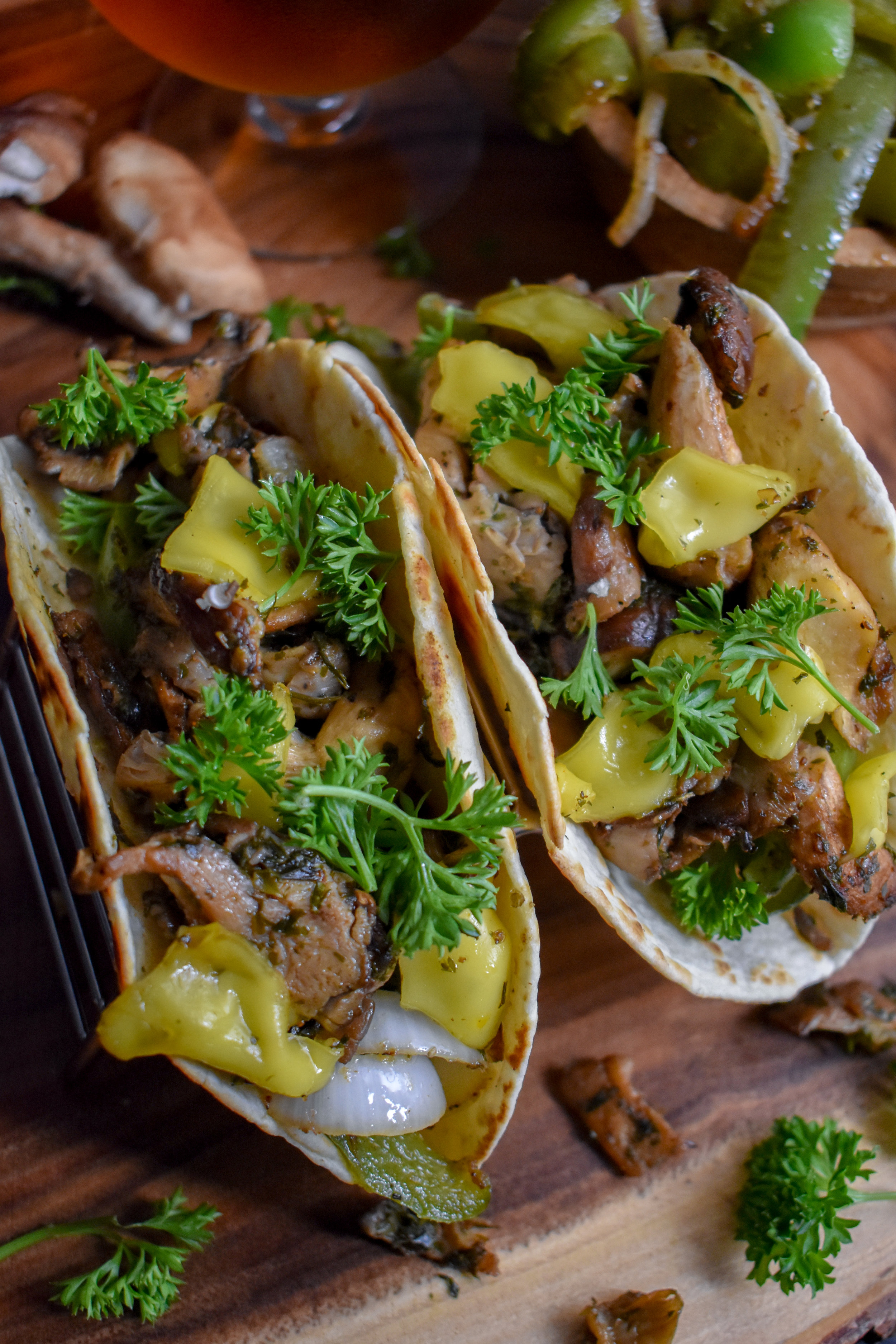 5. To finish, I like to brown some tortillas on the stove top to give them a slight crisp. Load into the taco and top with some parsley. Enjoy!
