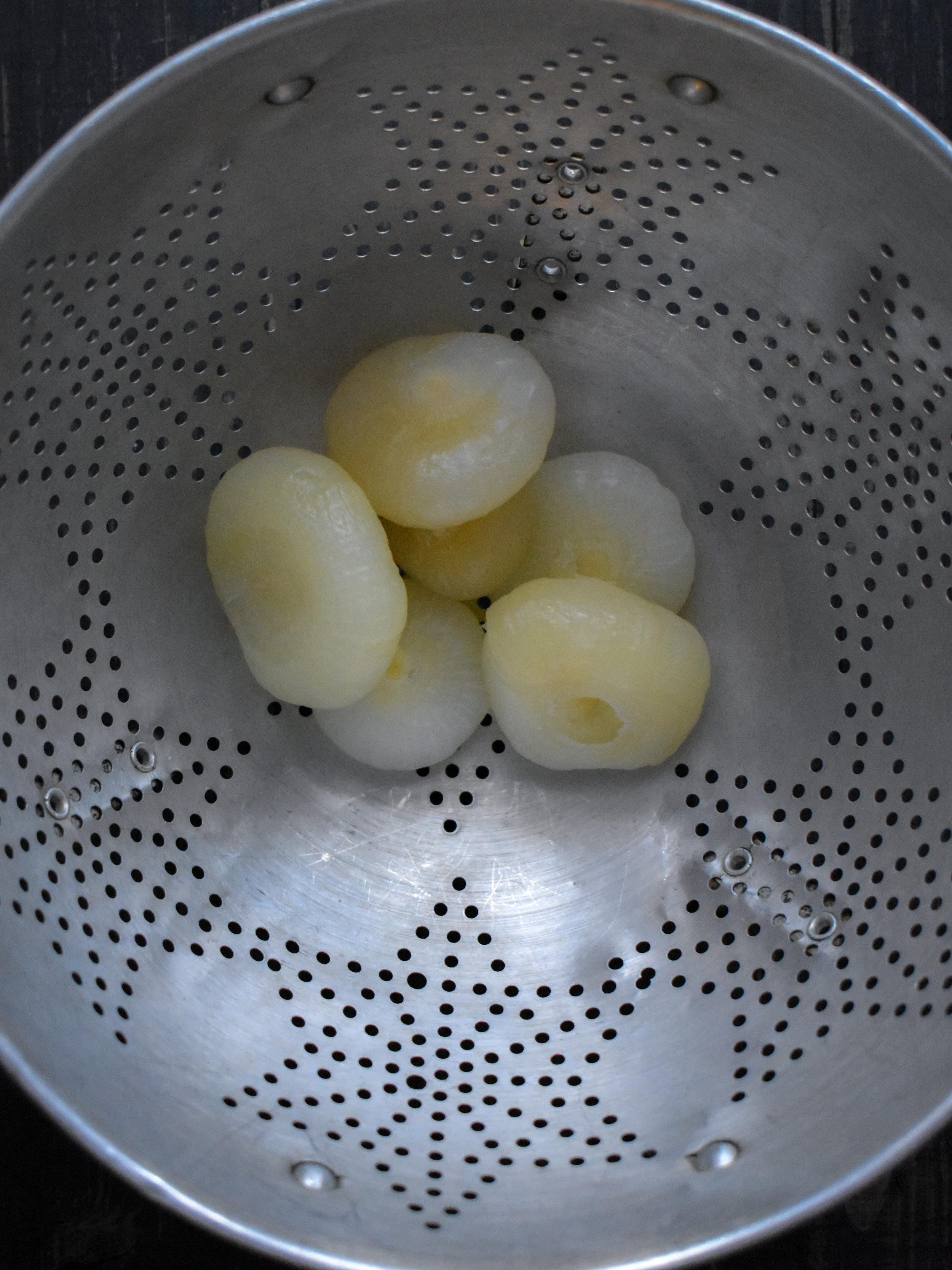 2. Bring a medium pot to a boil and add cipollini onions. Boil for 8-10 minutes until softened.