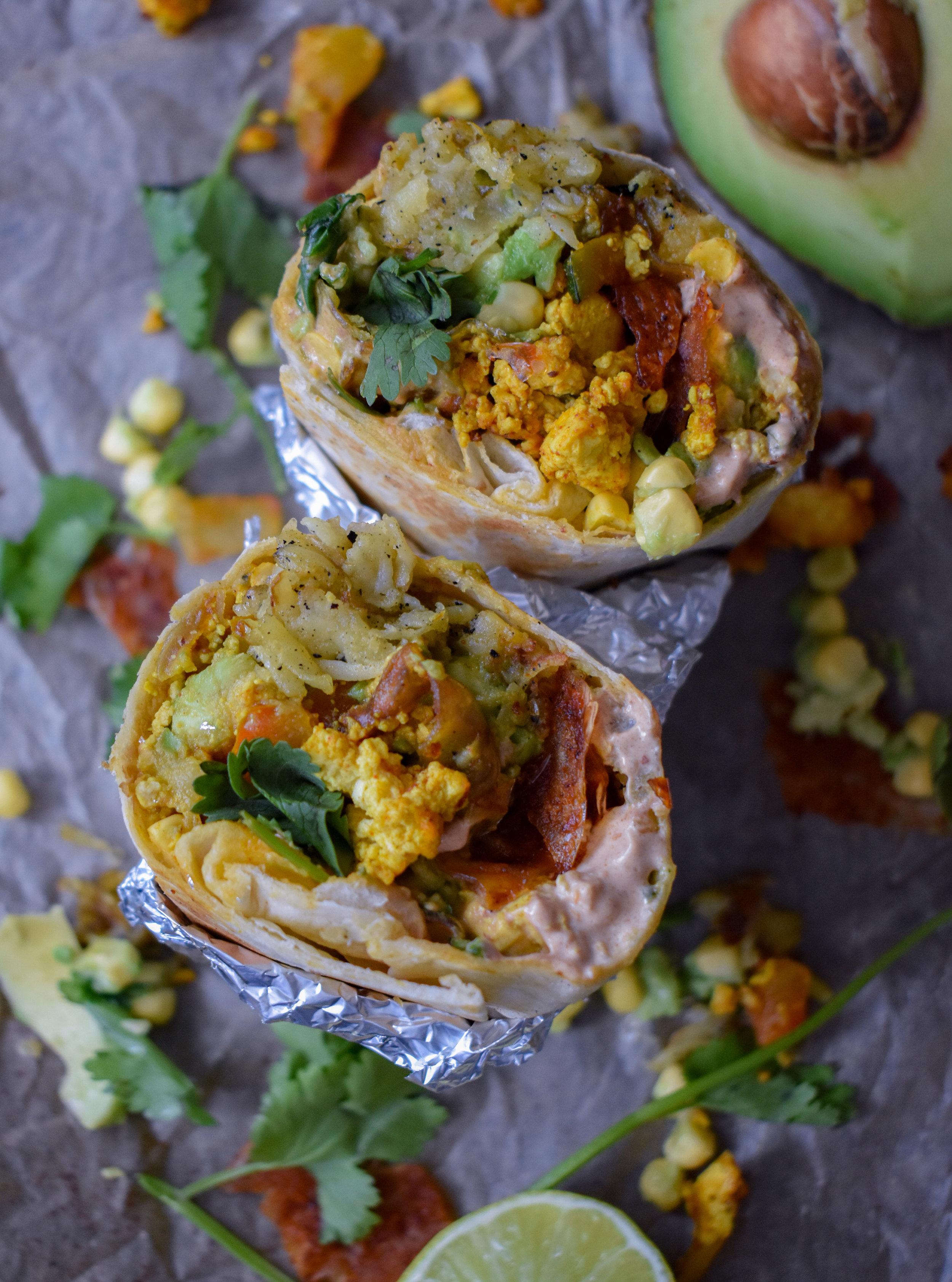 The Ultimate Vegan Breakfast Burrito W Crispy Hash Browns Vegan Bacon Turmeric Tofu Scramble Lime Corn Guac And Chipotle Sour Cream The Vegan Caveman
