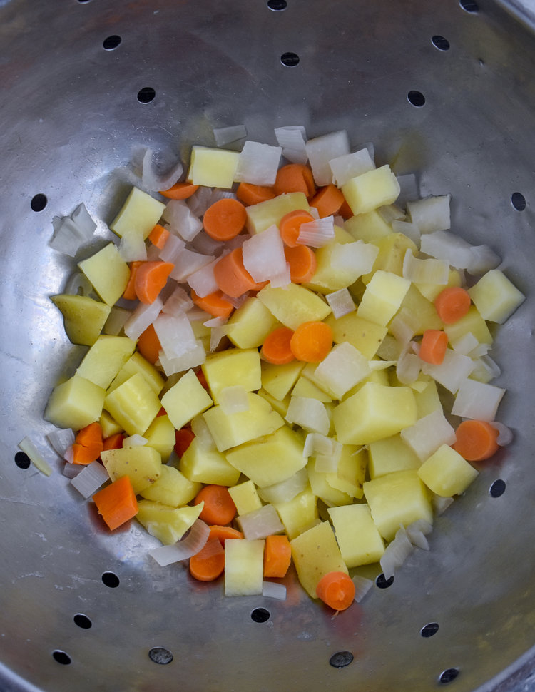 5. Bring 6 cups of water to a boil and add potatoes / carrots / onion to the boiling water. Boil for