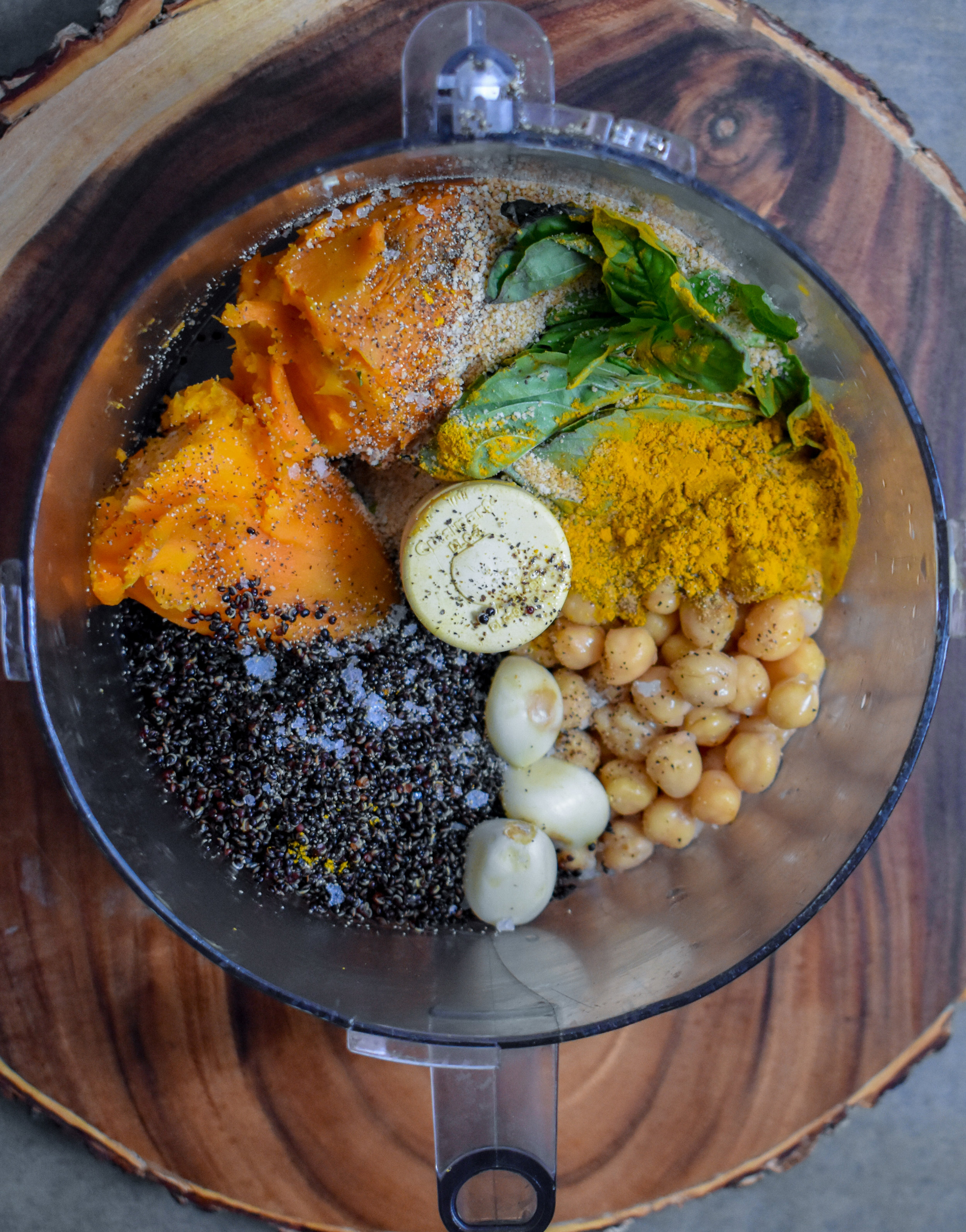 4. Once the sweet potato + quinoa are done, mix together all the ingredients for burger (including cooked onion + pepper) in a food processor (except AP flour) and pulse 8-10 times. Don't overmix it as you want some chunks of sweet potato to still exist.