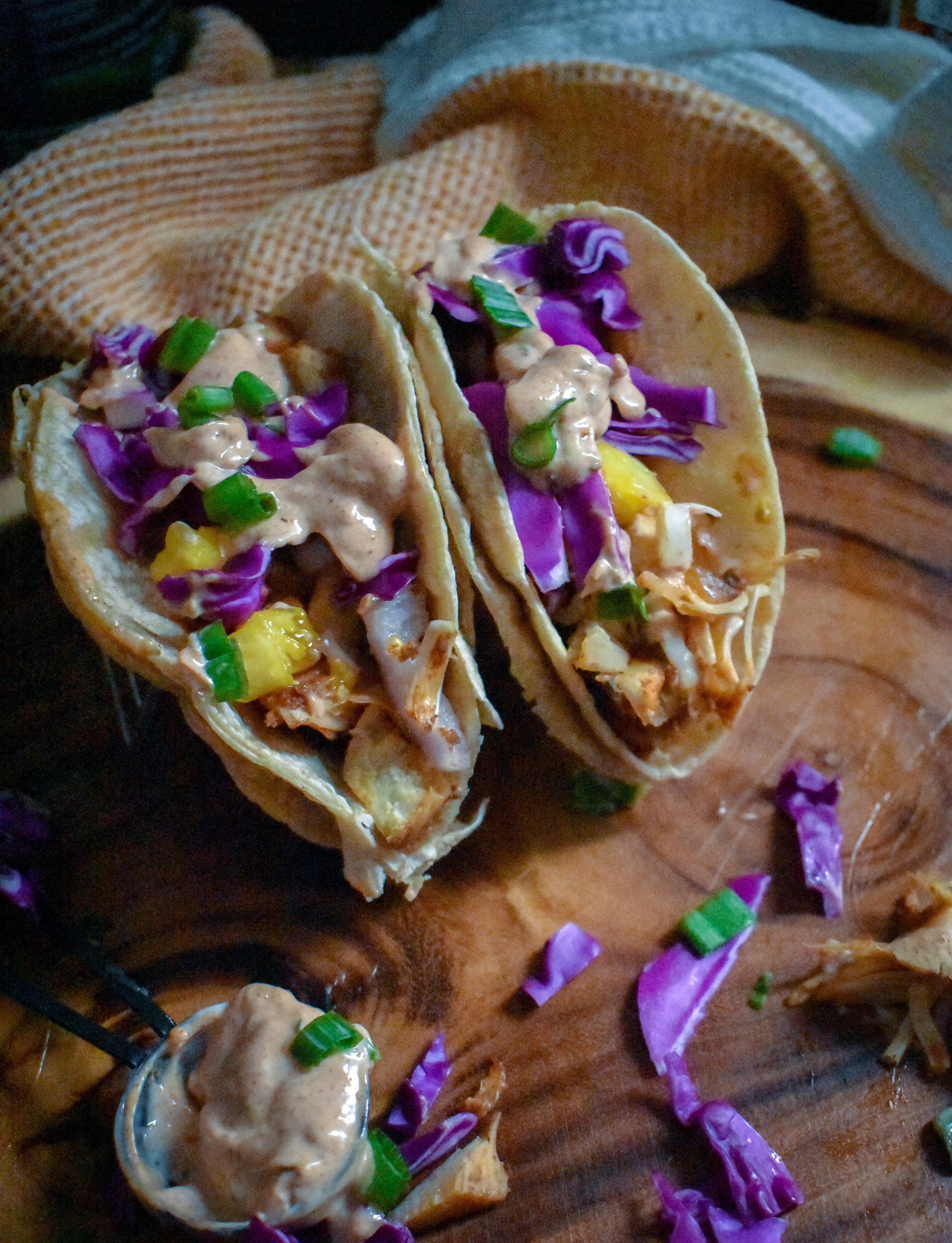 6. To construct, add jerk chicken then cabbage then slaw and finally the aioli.