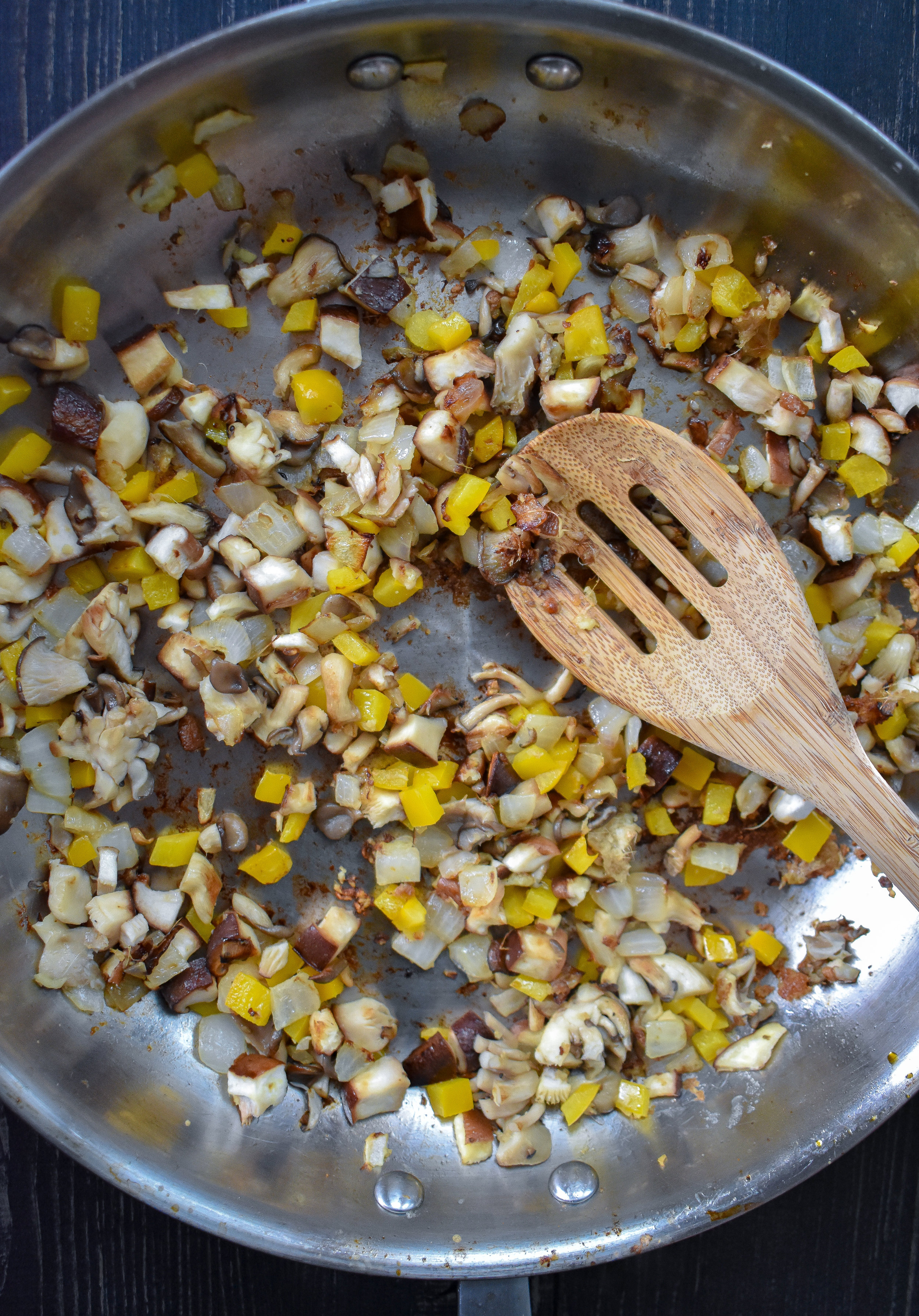 1. To start, add 2 tsp sesame oil + butter for the filling to a large frying pan (could use a wok on medium low heat) over medium heat. Heat for 60 seconds. Add onion, garlic, and ginger. Cook for 4 minutes. Add mushrooms, peppers, salt, pepper, and fennel. Cook for another 3-4 minutes until mushrooms start to soften.