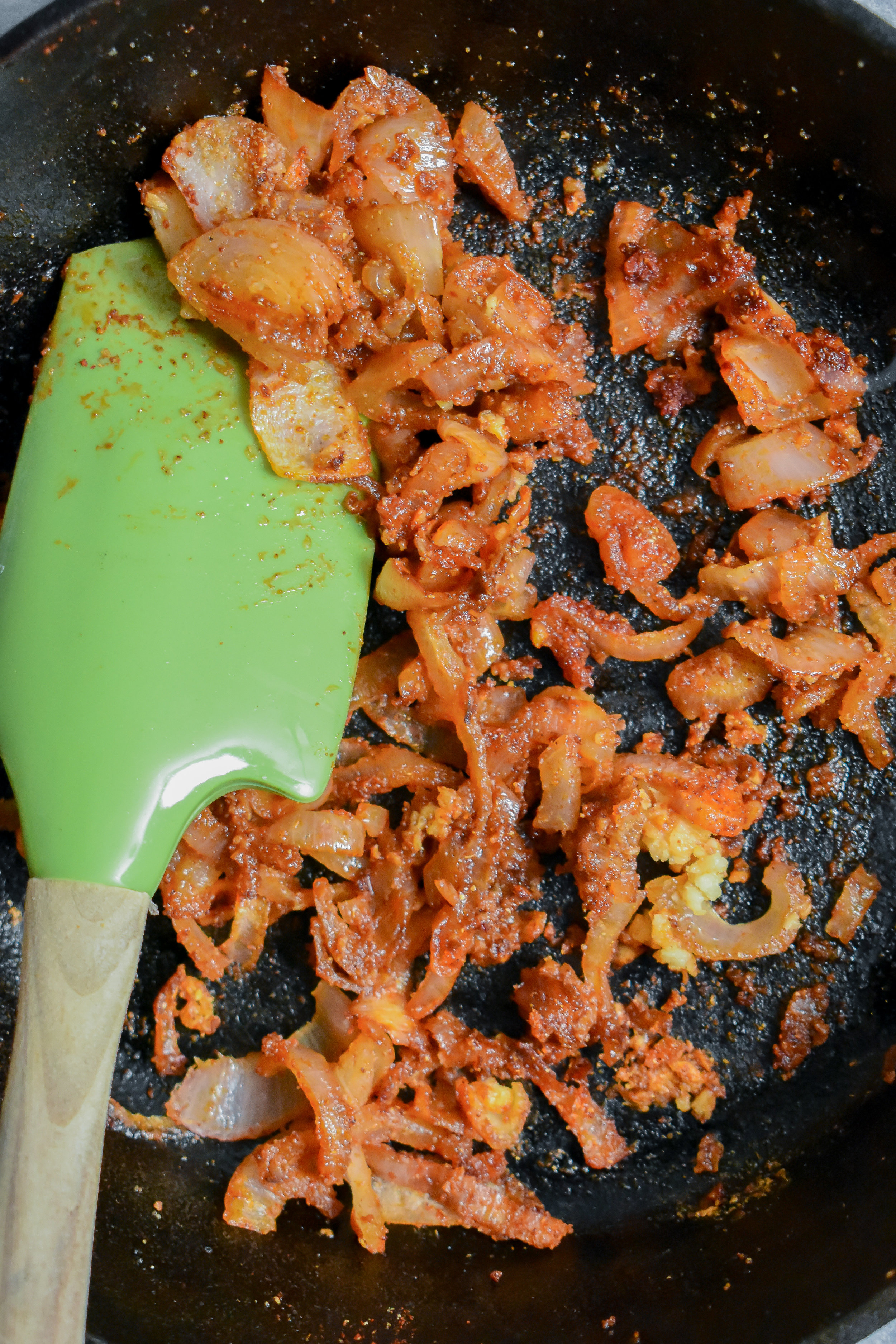 2. Next, add oil to a small castiron pan and warm over medium heat for 60 seconds. Add shallot and garlic to pan and cook for 4 minutes. Add spices and continue cooking for 2 minutes. Remove from heat and set side.