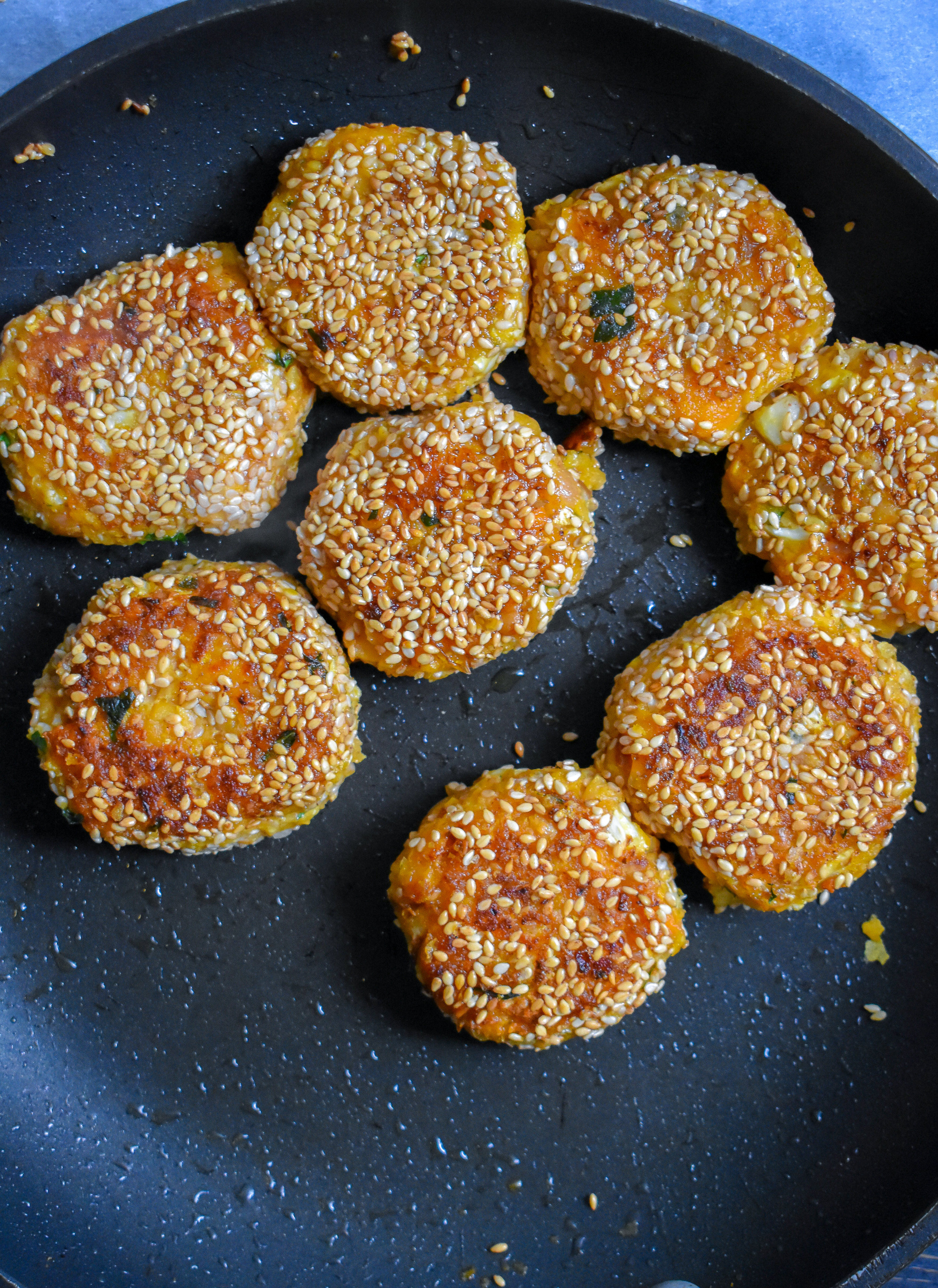 5. Add 7-8 falafel patties to a medium to large frying pan and cook over medium-high heat for 4-5 minutes until browned and crispy on each side.