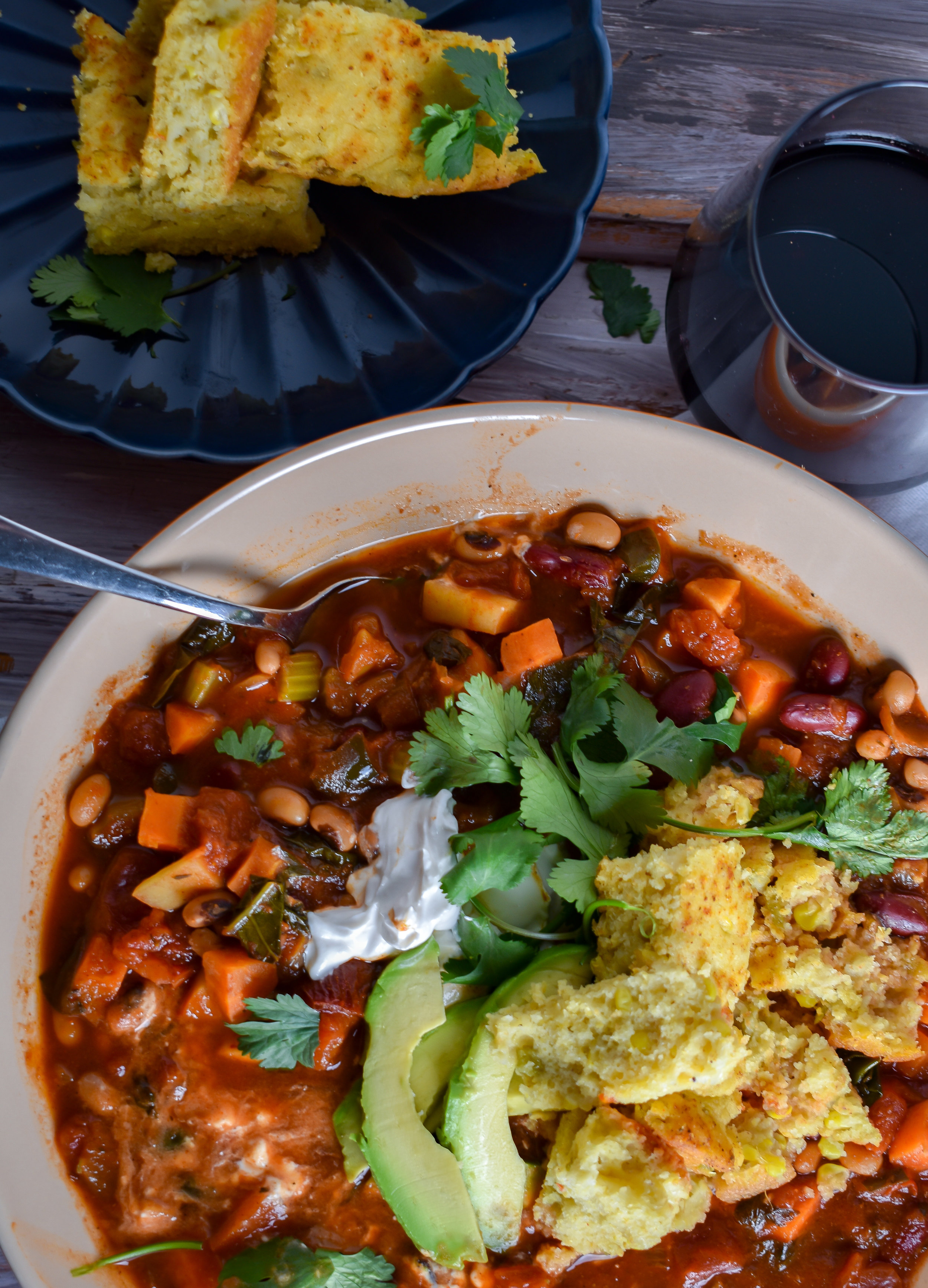 7. When the chili is done, serve in a bowl with cornbread. I like to add some vegan sour cream, avocado, cilantro, and cornbread with mine!