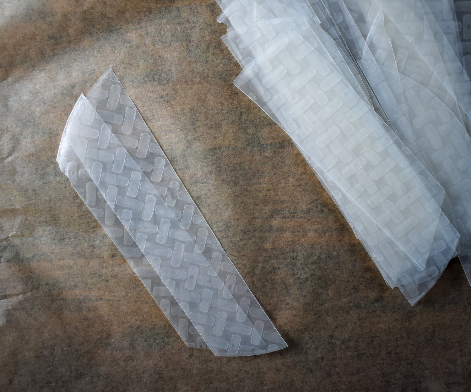 2. To form, find two like pieces of rice paper and stack them together. I like to stack all my pairs on a parchment sheet before wetting.