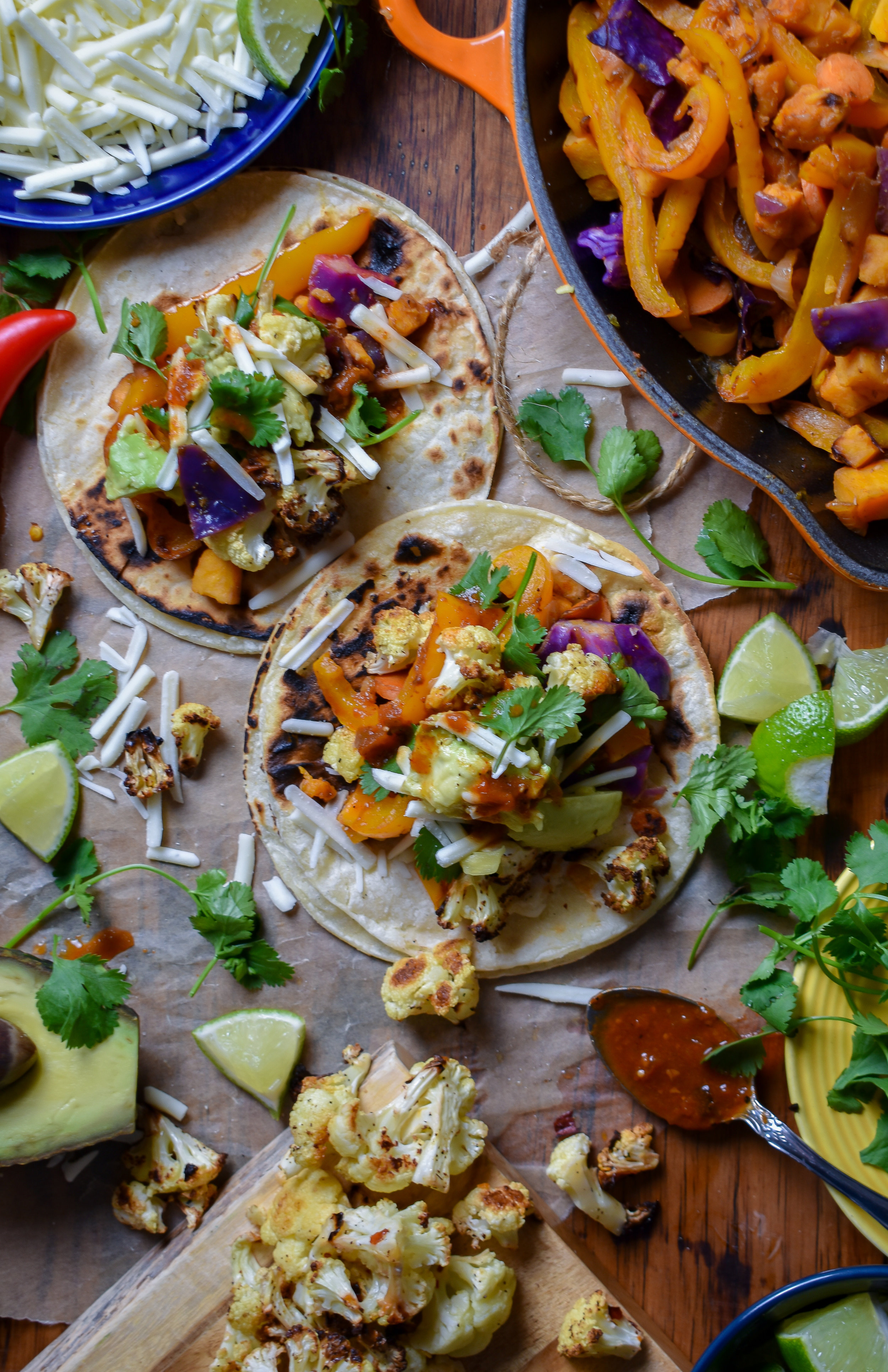 4. To finish, char your tortillas on a hot dry pan over high heat. Cook for 10-20 seconds on each side. Serve with salsa, fresh cilantro, lime wedges, avocado, dairy-free cheese, and any other fajita favs!