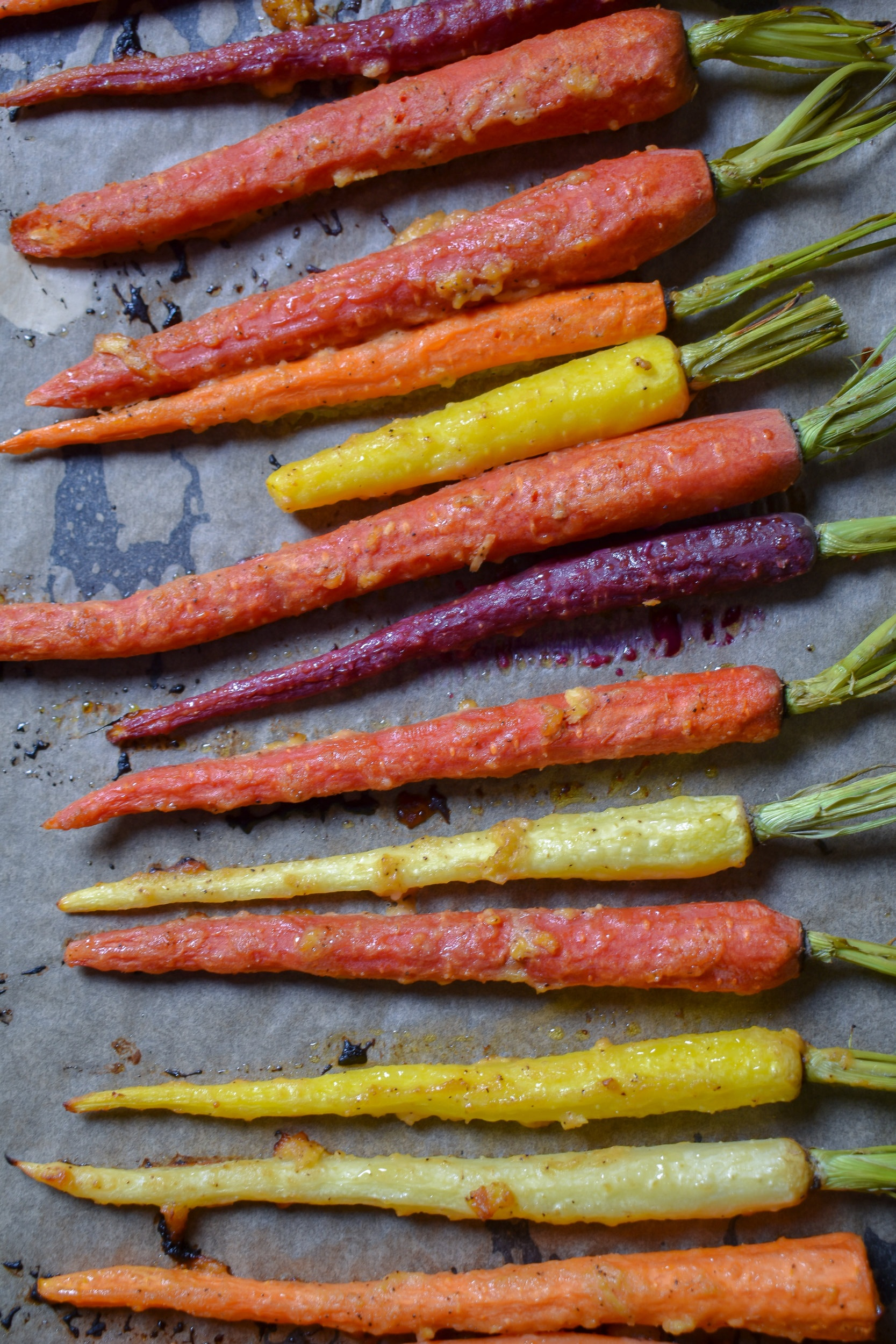 2. Place the carrots into the oven and bake for 20-30 minutes. It really depends on how crunchy you like your carrots and how thick they are. A good test of if they are done is pull them out, push a fork into them. It should push through with some light tension.