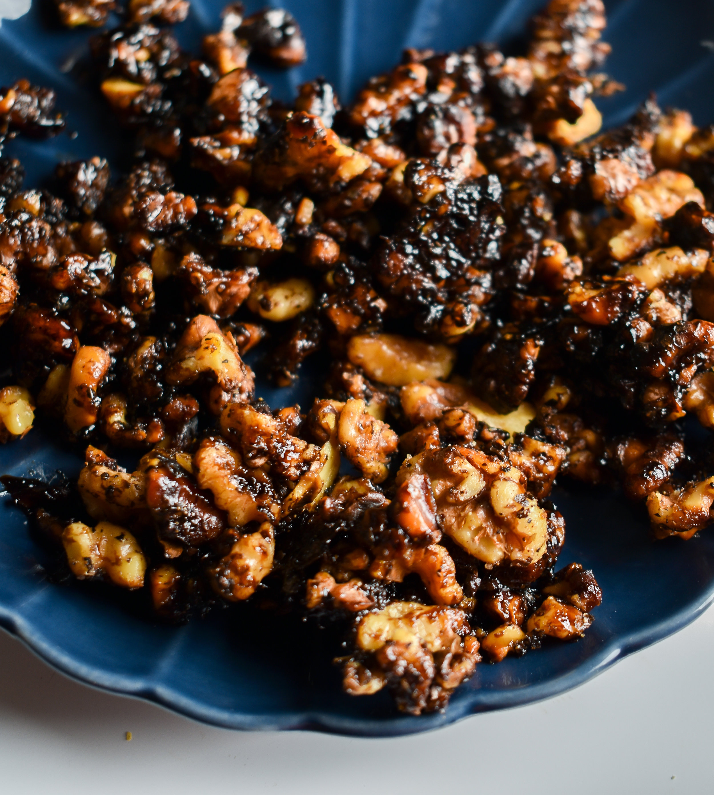 3. While the beets roast and pear cook, dice up the walnut and add to a dry medium pan. Toast for 6-8 minutes over medium low heat until it starts to become fragrant. Add butter and cook another 2-3 minutes then add balsamic glaze and salt and pepper. Take off heat and let sit. Set aside.