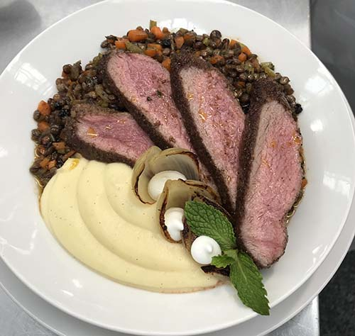 pan roasted lamb loin with moroccan spice,puy lentils, parsnip puree, whipped feta and charred onions - Serves 4