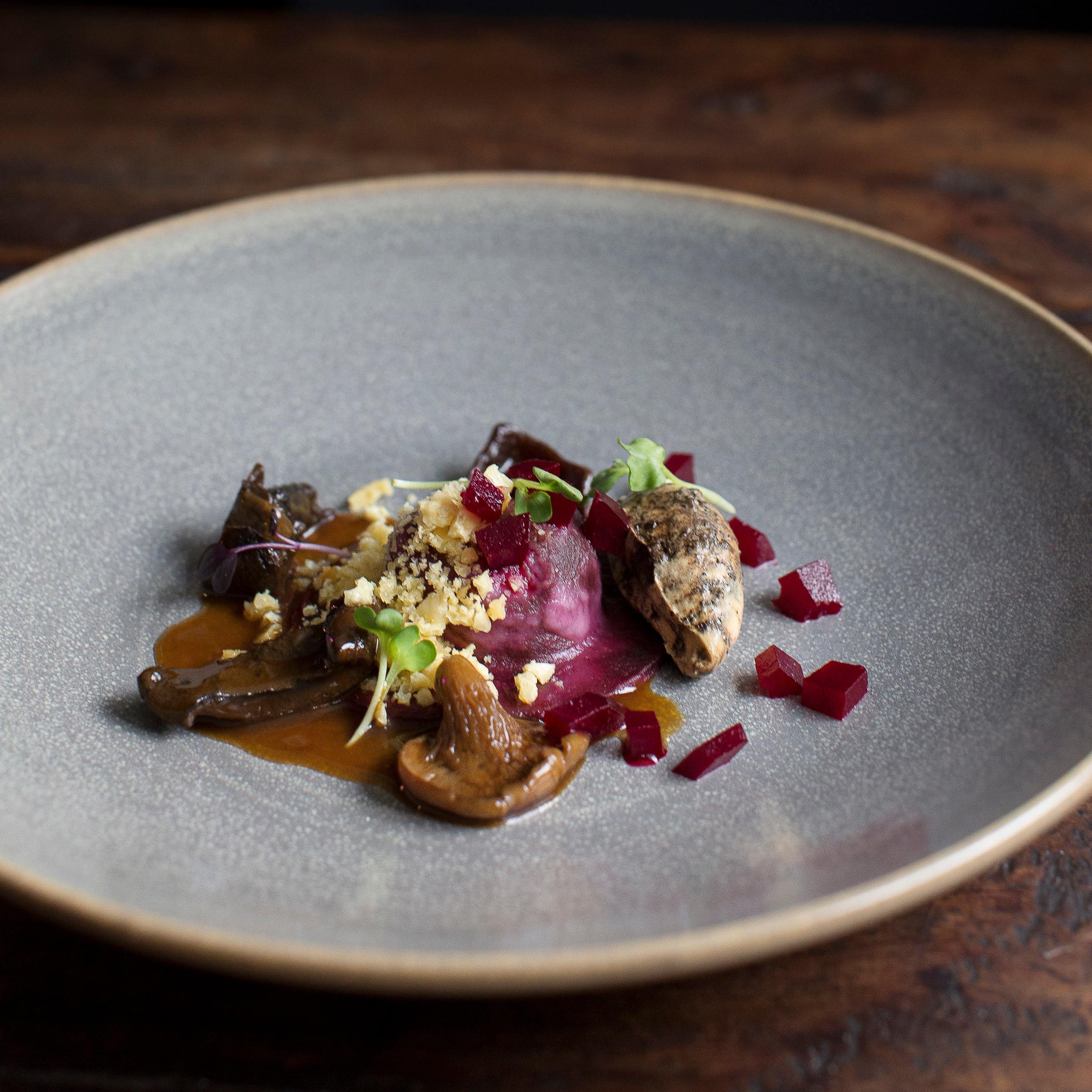 Braised lamb shoulder ravioli, Otematata mushrooms, beetroot