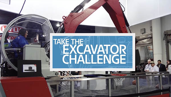 Eaton Excavator Challenge with excavator and visitor working to dunk a basketball
