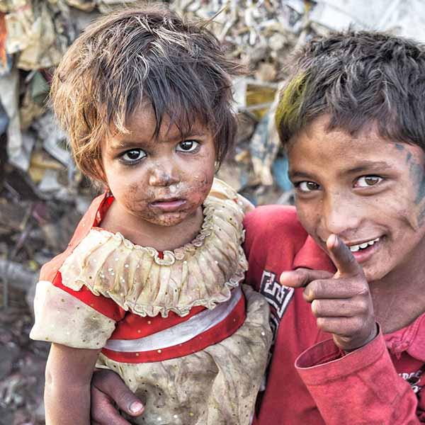 Two children scavenging through waste.