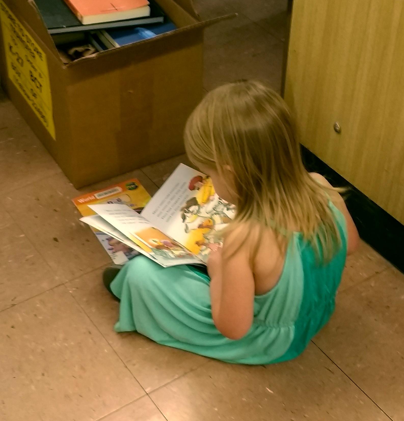 little girl reading.jpg