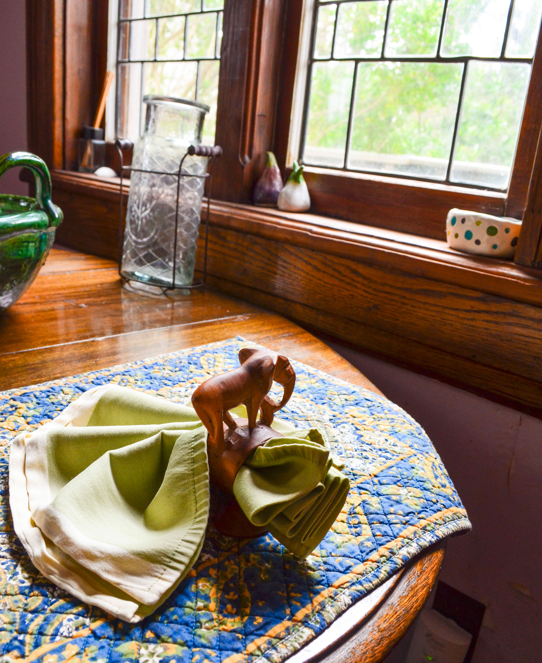 a wooden elephant napkin ring on the table at the Bridge Cottage at B. Bryan Preserve in Point Arena on the Mendocino Coast