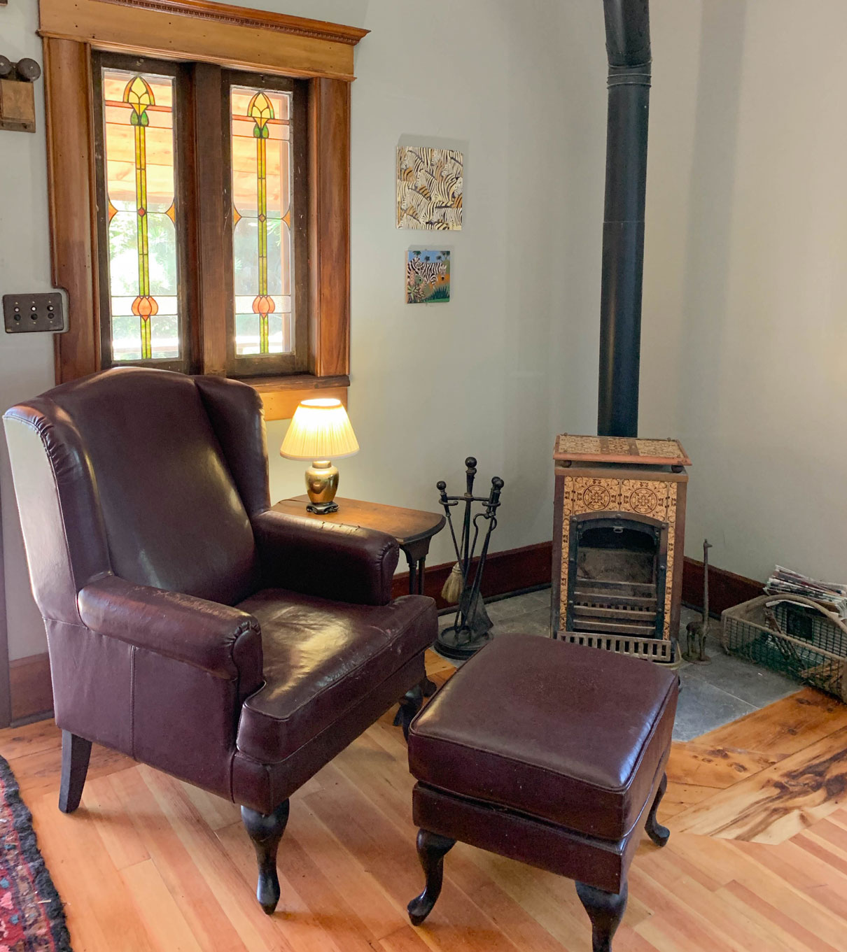 A leather chair by a wood burning stove in the Zebra Cottage at B. Bryan Preserve in Point Arena