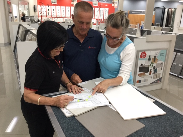 Clients, Anna and Joost, being guided through their selections experience at Beaumont Tiles.