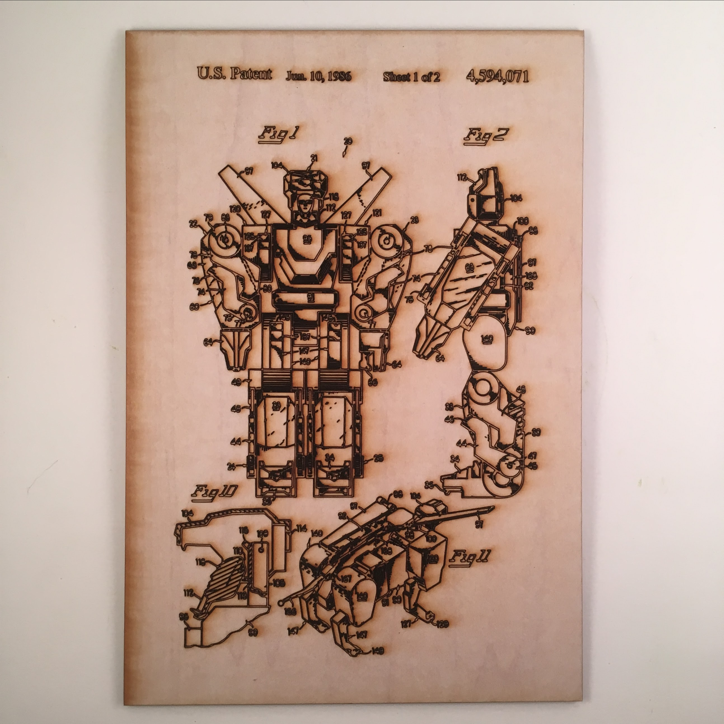 The original Voltron Patent laser cut into wood using our Glowforge.