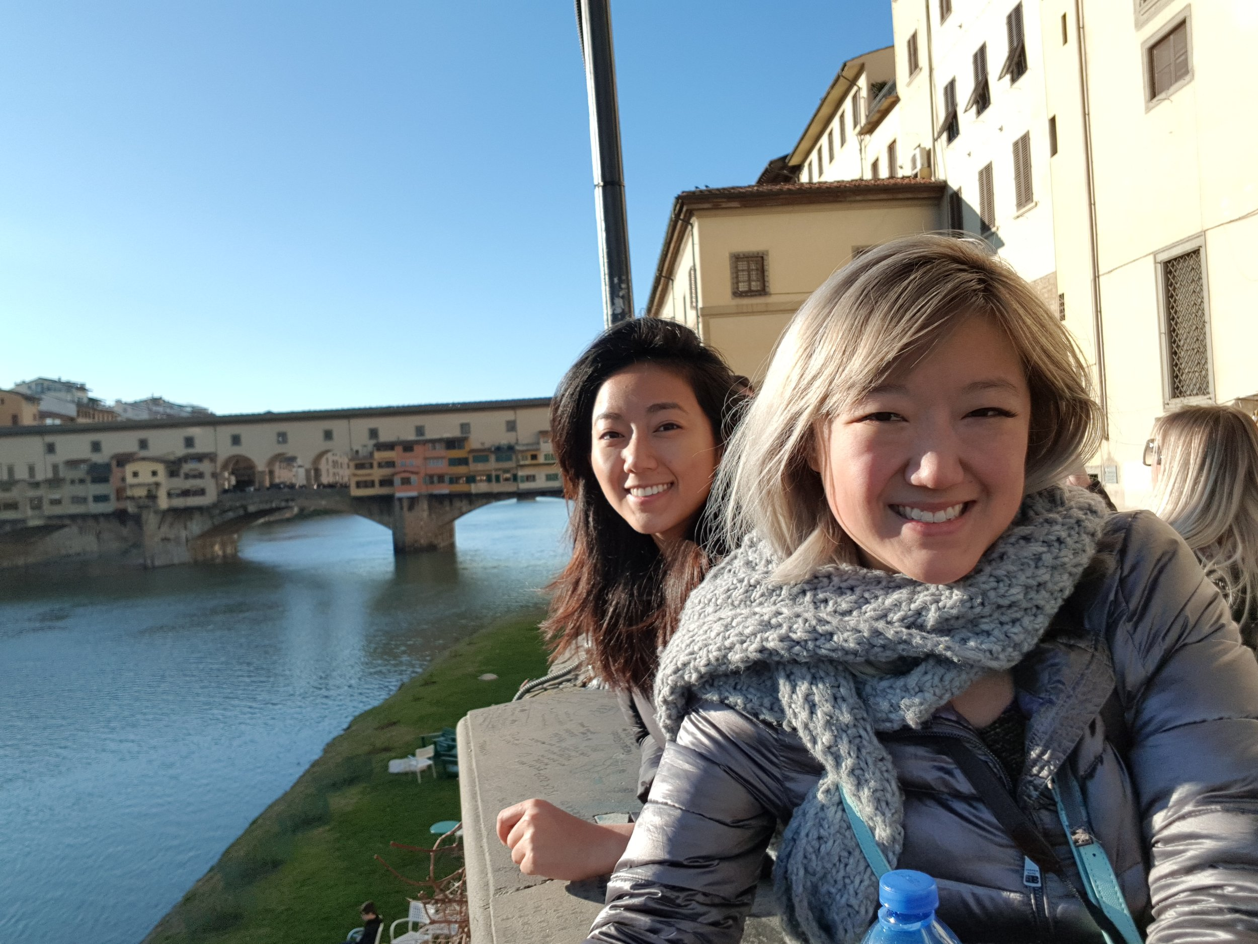 """For some reason, the thing my mom remembers the most about Florence is the Ponte Vecchio. So we made sure to take a picture next to it. I'm not saying I don't remember it, but thanks to Assassin's Creed, I will never not associate it with the place where  Ezio Auditore got his ignoble start  by dueling with a rival family's dickhead of a son. BTW, when I first played ACII, I was like """"Wow! This actually looks exactly like how I remember Florence to be!"""" and this time when I went back to Florence I was like """"Wow! This actually looks exactly like how I remembered ACII's Florence to be!"""" So good job, Ubisoft. You made me want to climb everything I saw."""