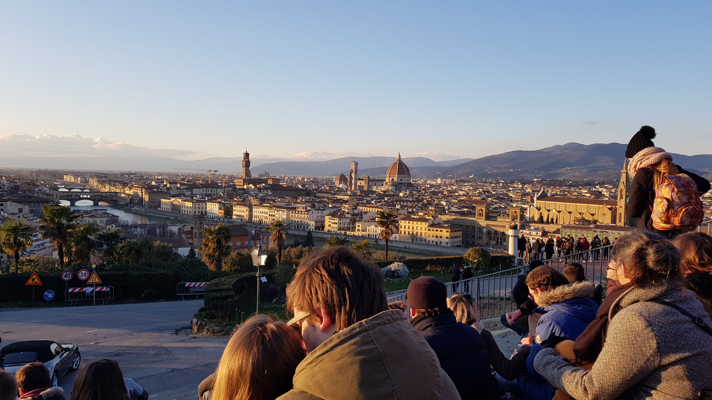 We walked up to the Piazzale Michaelangelo to freeze a little while watching the sun set over one of the most fantastic views of the whole city. I've gotta give props to the vendors up there - their wine was incredibly reasonably priced for being the only cart selling wine. And how can you not want to enjoy this view with a little wine?