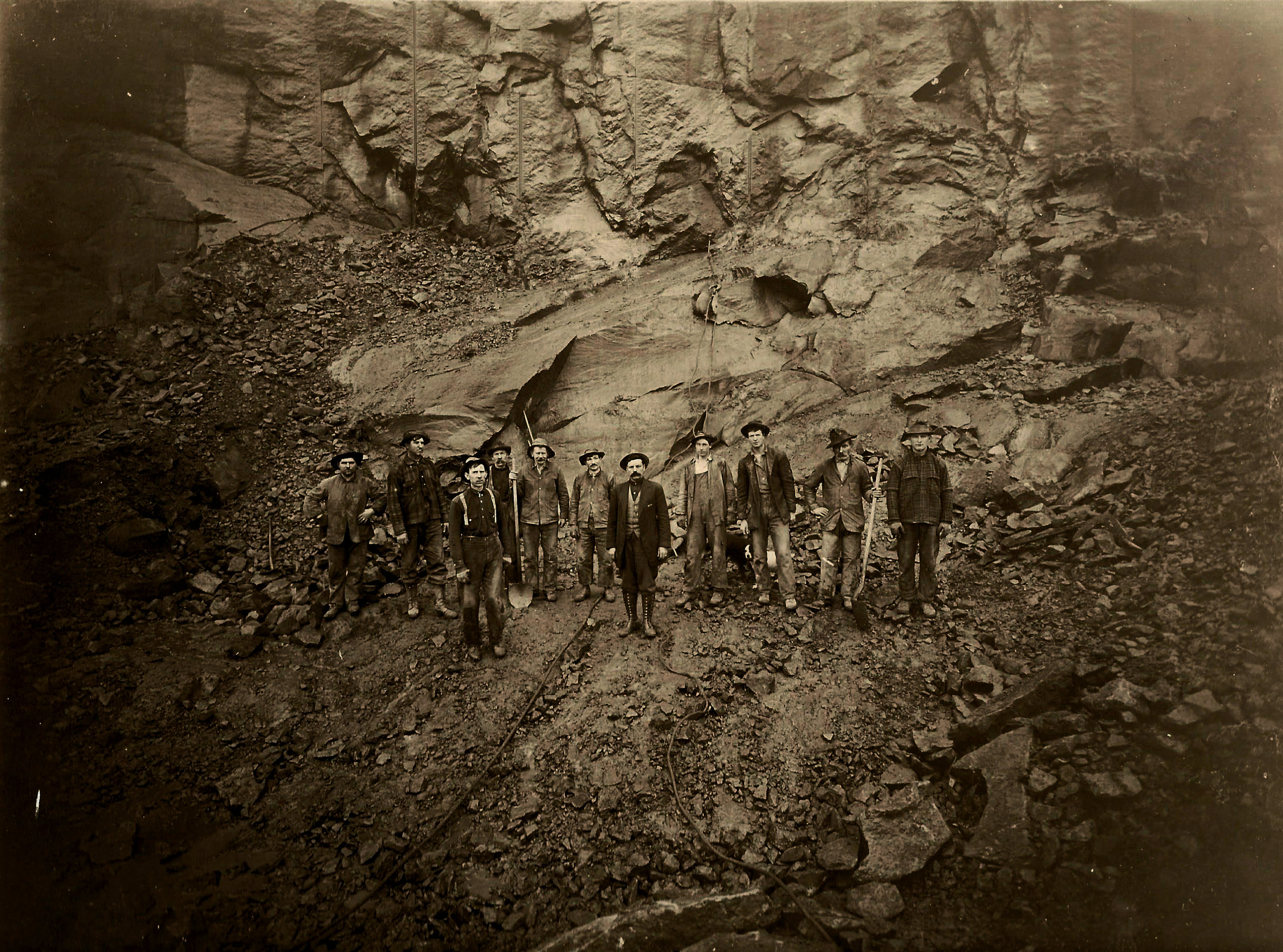 Workers of the Hercules Sandstone Company pose for a photo in the Hercules #6 quarry, where stone was blasted for use in jetties.