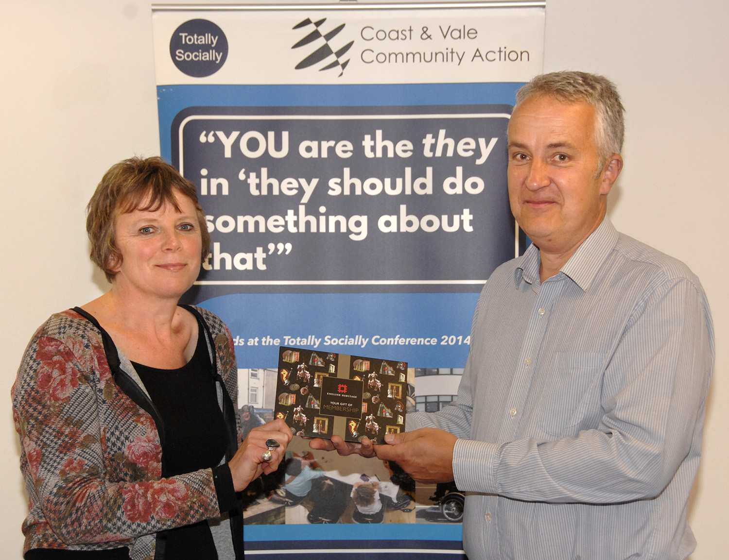 Lucy Wilkins accepts her English Heritage membership from David Stone (to order photos ring 353597)