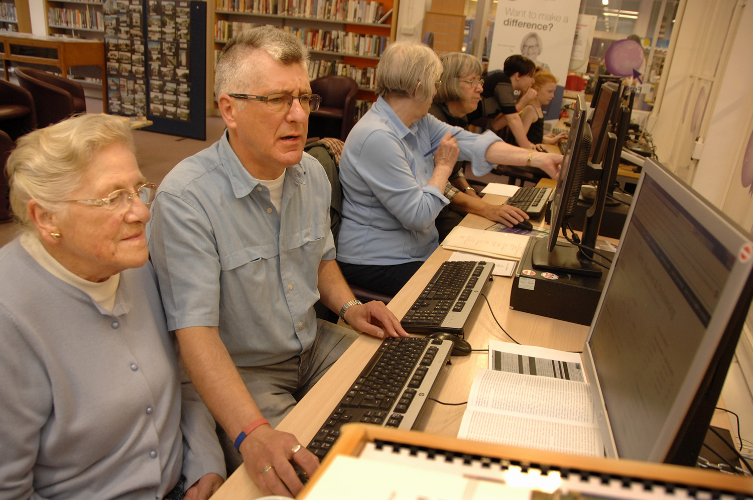 Volunteer Richard Crocker helps Valerie Barron research her family tree