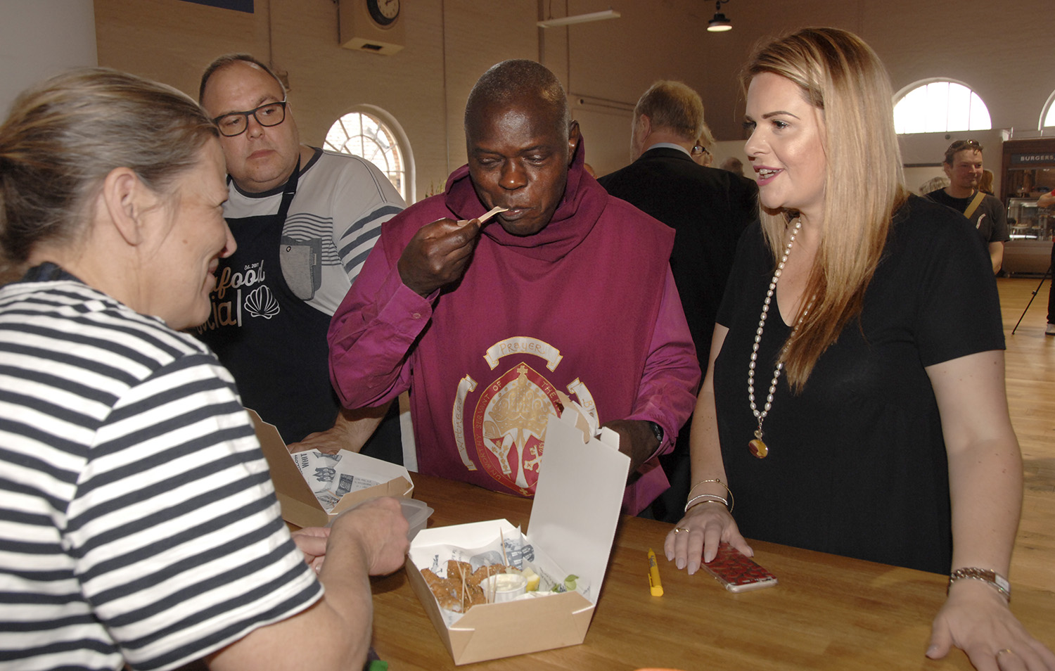 The archbishop tucks into scampi in the Market Hall