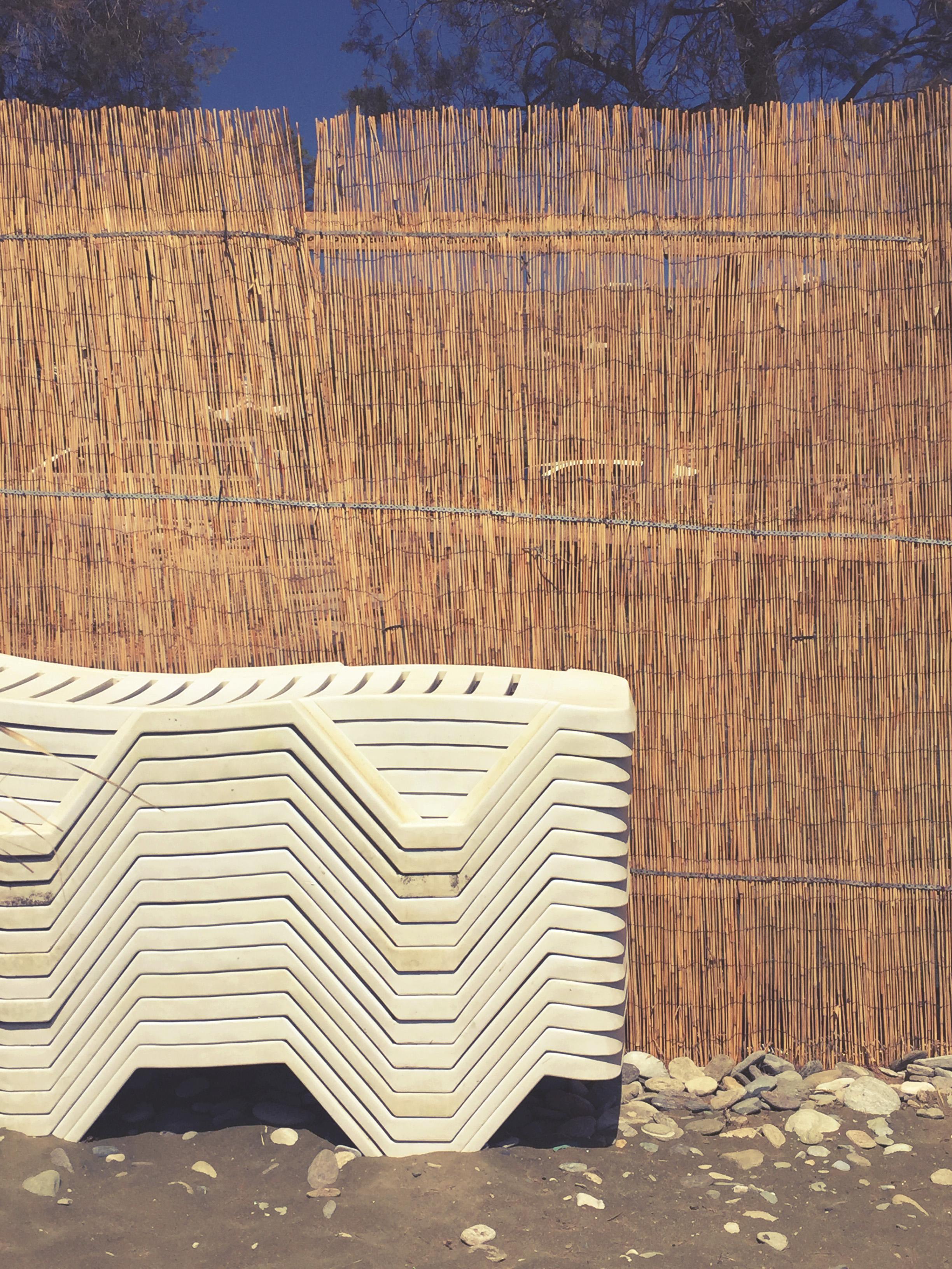 Sun loungers stucked up in Kionia beach