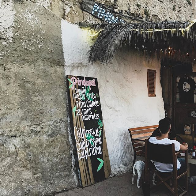 Pindapoi in Es Castell serves the freshest cocktails in Menorca in a laid back hippie setting overlooking the calm sea. Bonus point: when the moon is full you can see it peaking from the hill just in front of you
