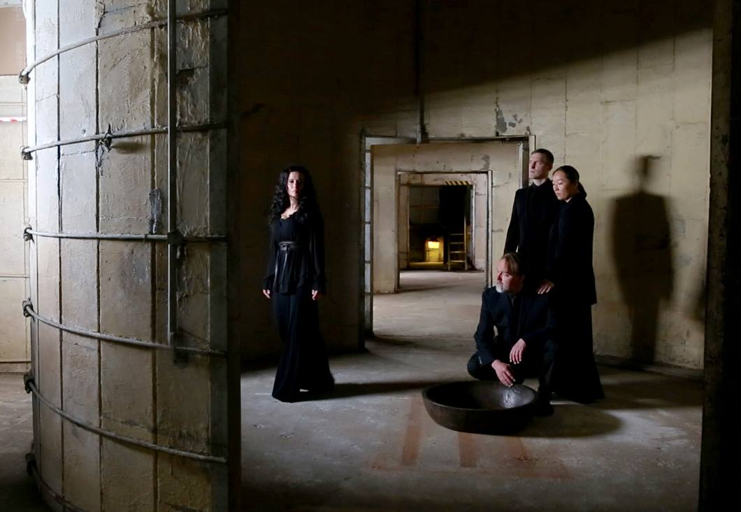Threshold: a site-specific new music work created for the stunning and sonorous Silos at Sawyer Yards / SITE Gallery. Sunday, April 30, 7pm. L-R:  Threshold . L-R: Misha Penton, soprano, concept, director. Chorus: Michael Walsh, Neil Ellis Orts (kneeling), Sherry Cheng,. Photo by Raul Casares