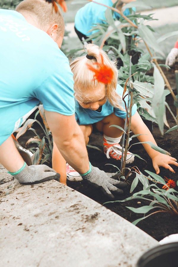 children gardening with adults.jpg
