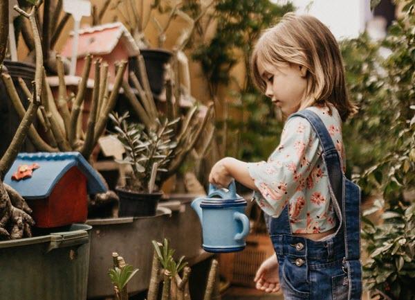 child watering plants.jpg