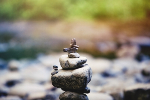 Rocks balancing in zen stack with blurry background