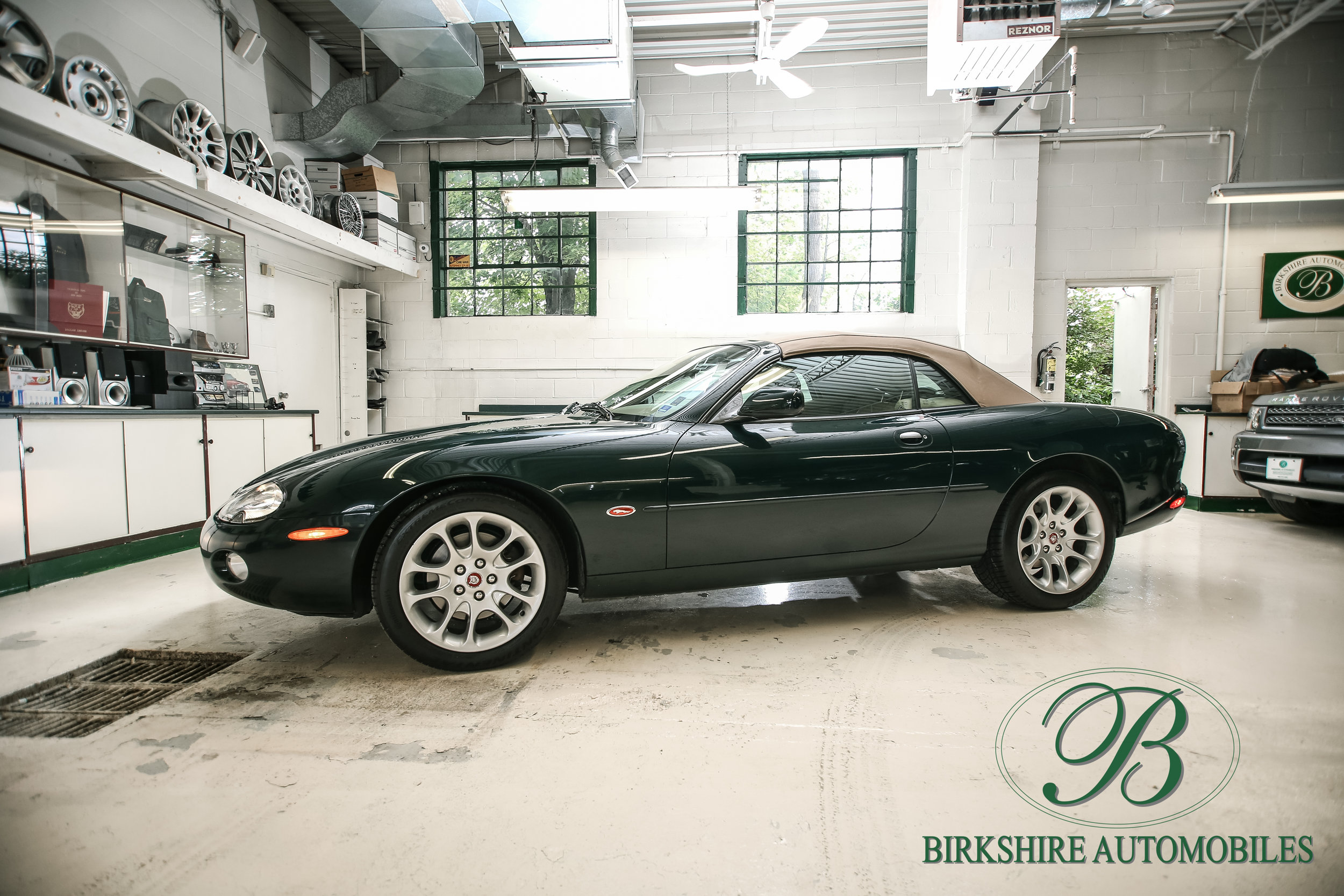 2001 Jaguar XKR Convertible - SOLD - Available in classic British Racing Green over tan leather interior and matching tan soft top.