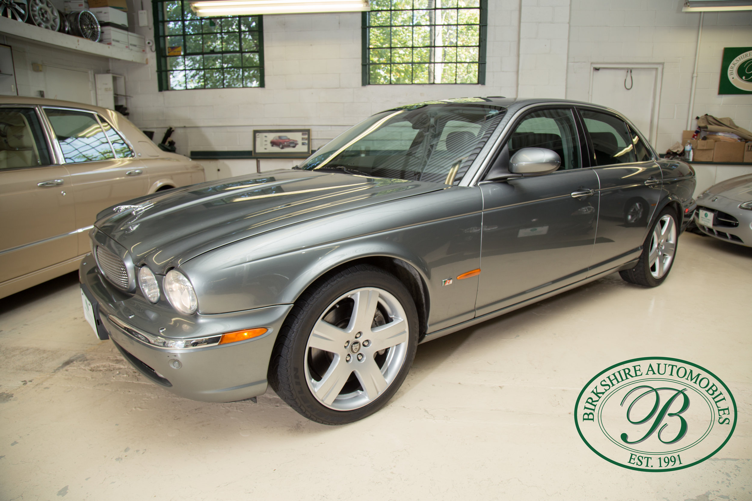 2006 Jaguar XJR - This stunning Jaguar XJR is powered by a supercharged 4.2-litre V8 boasting 400 horsepower and buckets full of low-end torque.